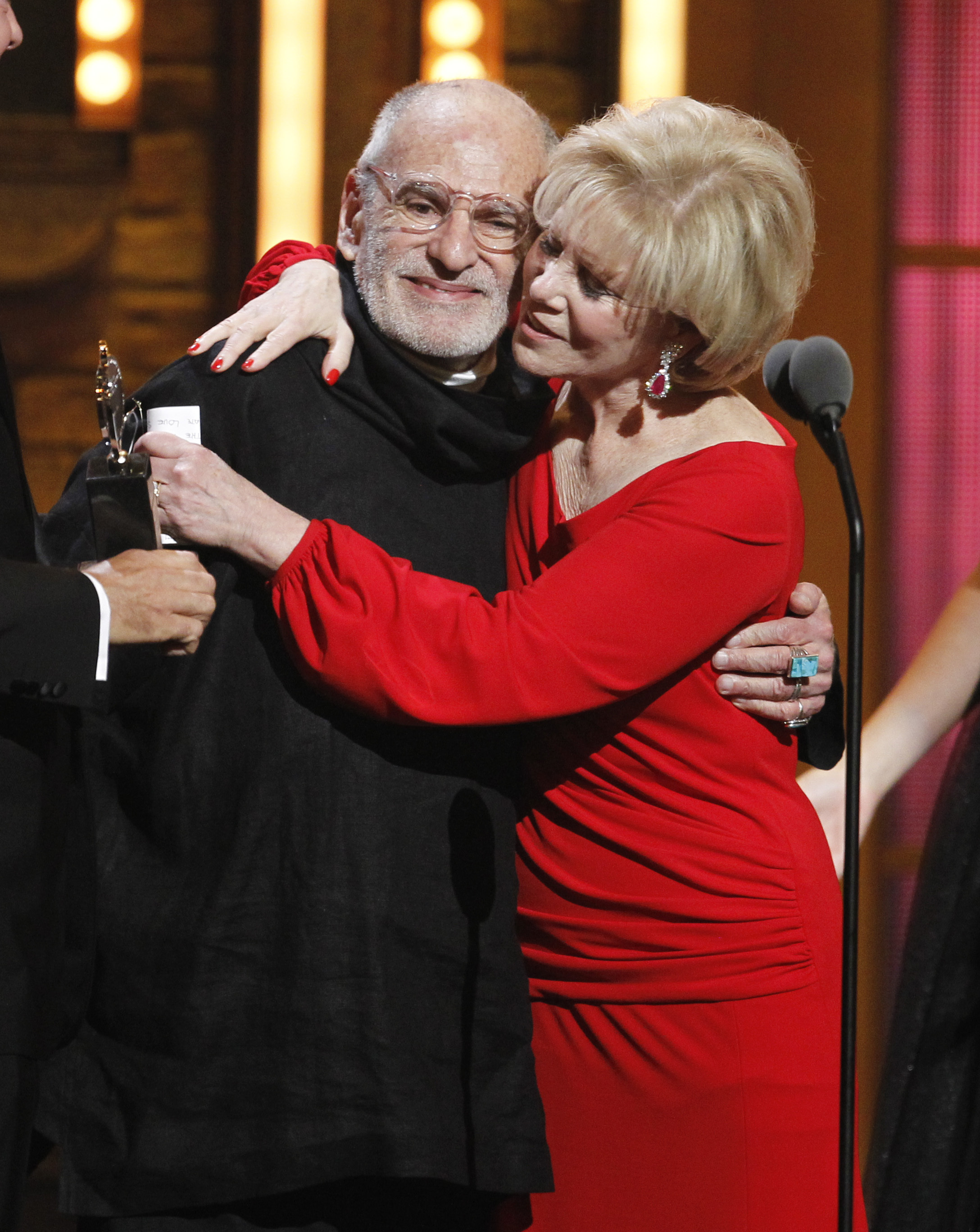 "Larry Kramer (left) and Daryl Roth embrace after they won the Tony Award for best revival of a play for ""The Normal Heart"" during the 65th annual Tony Awards in New York in 2011."