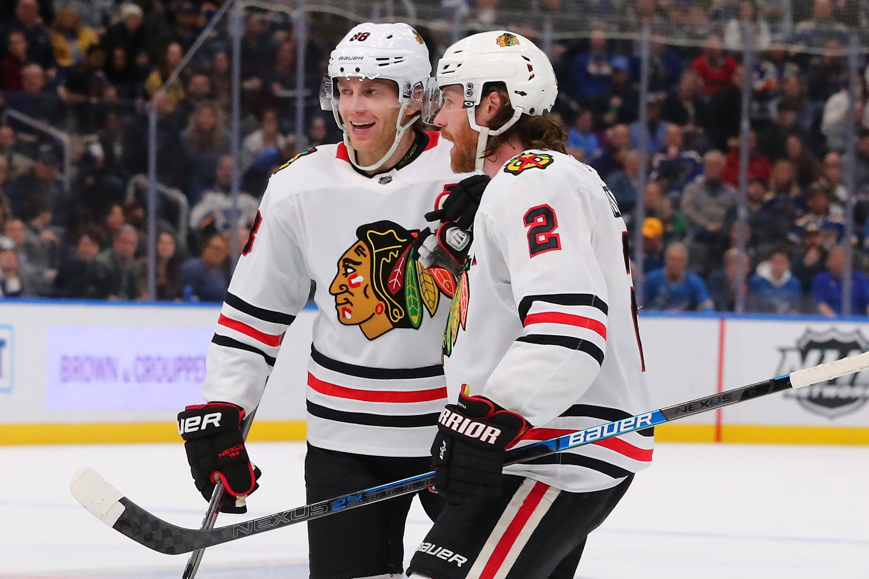 Patrick Kane (left) and Duncan Keith celebrate a goal by Keith against the Blues in February.