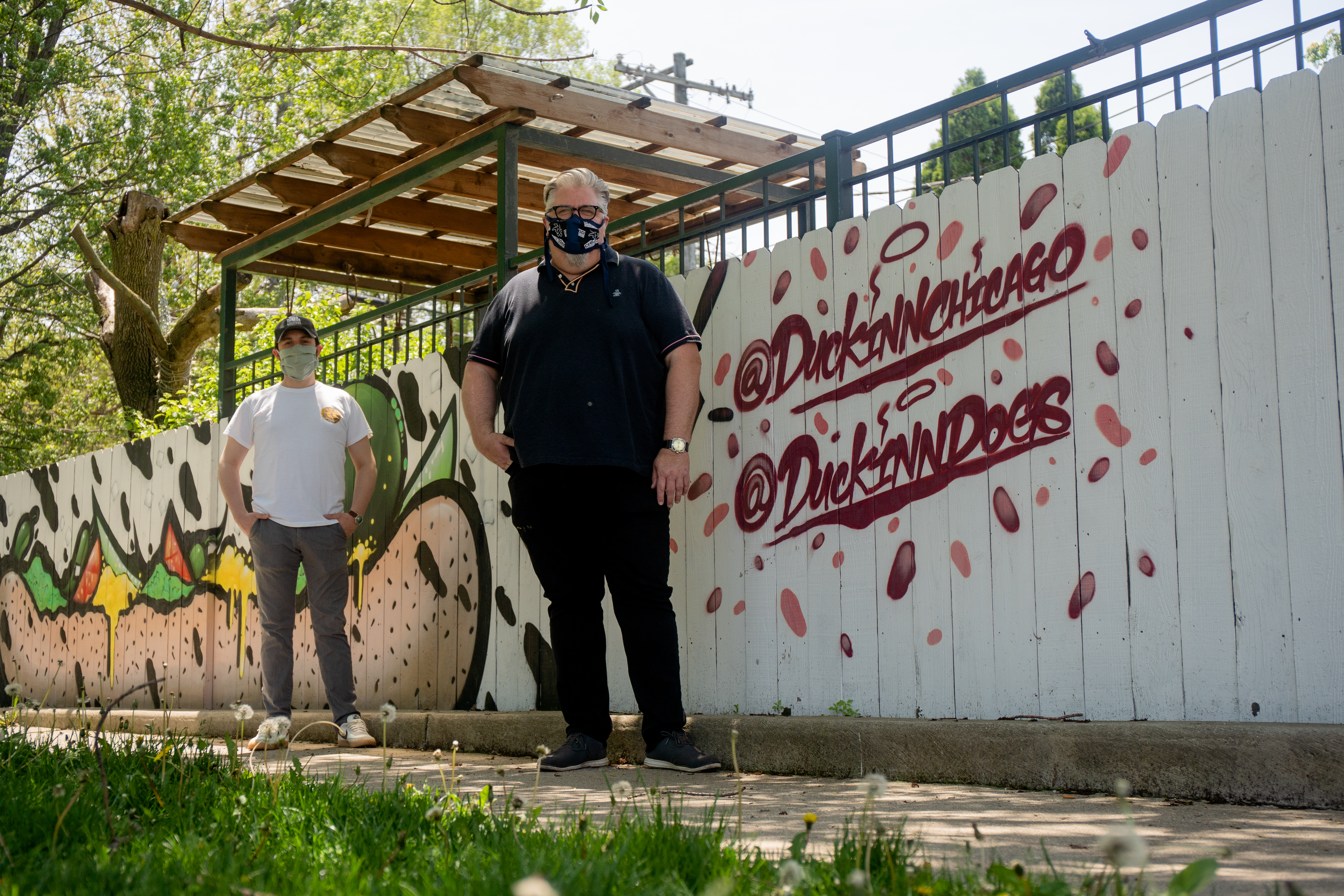 Kevin Hickey, owner of The Duck Inn, and Brian Phillips, the beverage partner of the restaurant, pose for a portrait outside the restaurant on May 24, 2020.