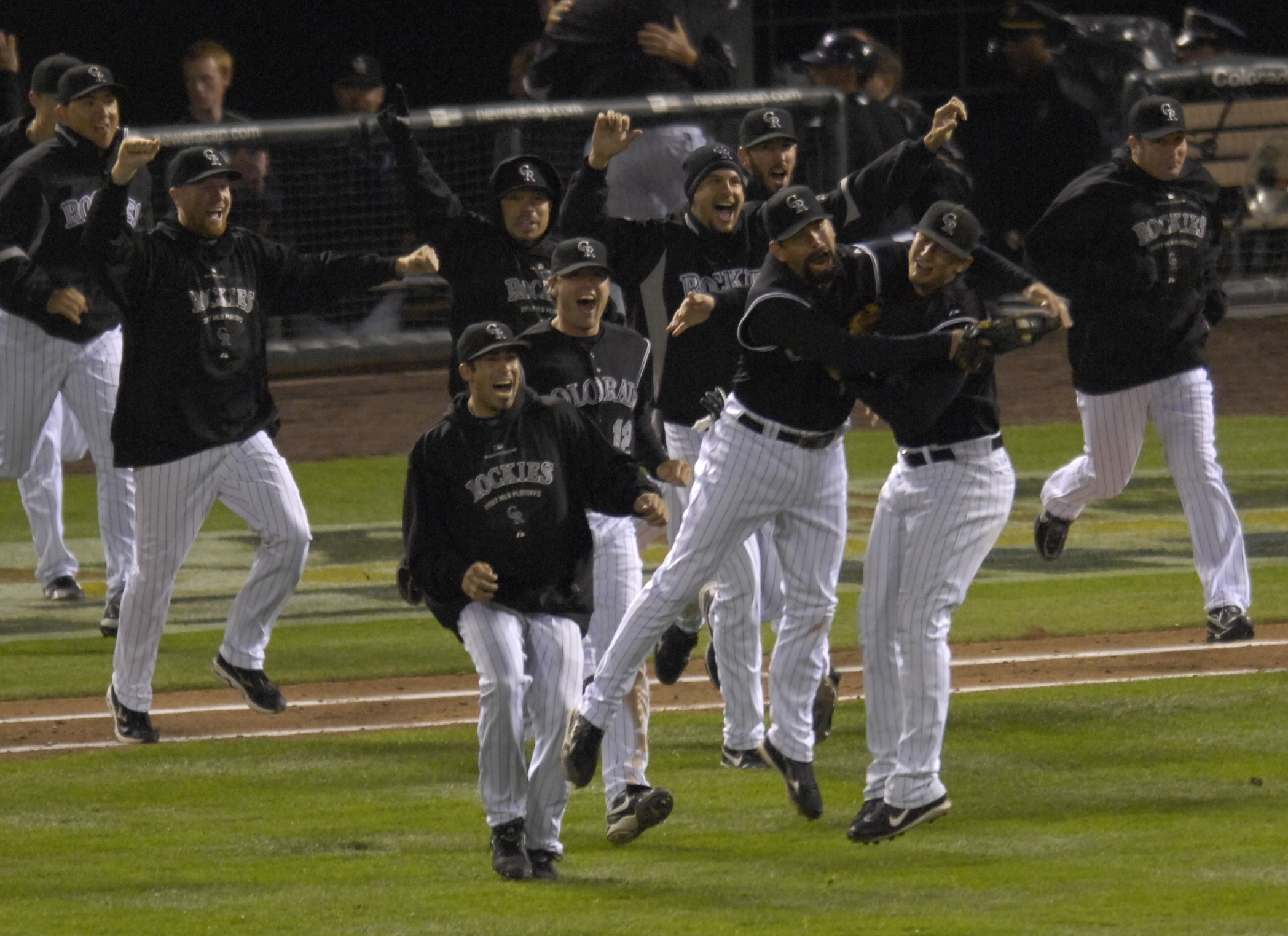 10.15.2007 — Colorado Rockies Todd Helton grabs on to short stop Troy Tulowitzki as the two celebrate after winning 6-4 in game 4 the National League Championship series between the Colorado Rockies and Arizona Diamondbacks Monday, Oct. 15, 2007 at Coors