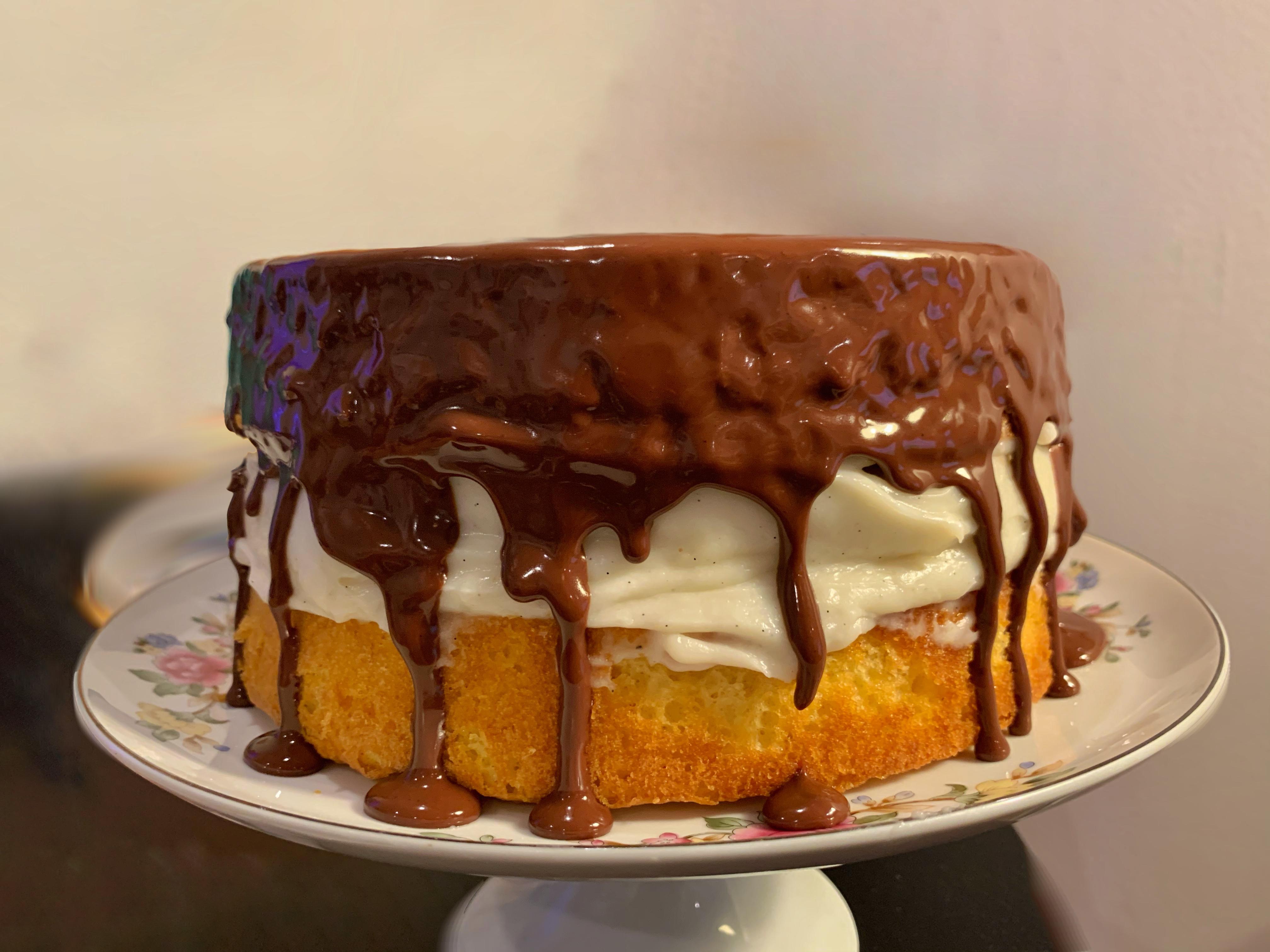 A Boston cream pie on a cake plate