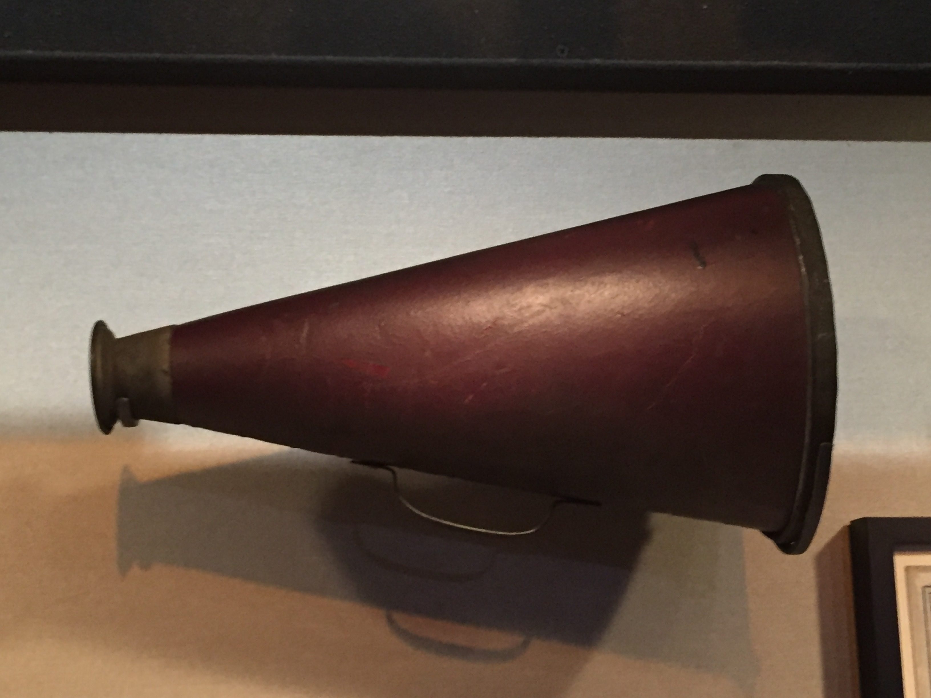 An old-style brown megaphone on display at the Chicago History Museum.