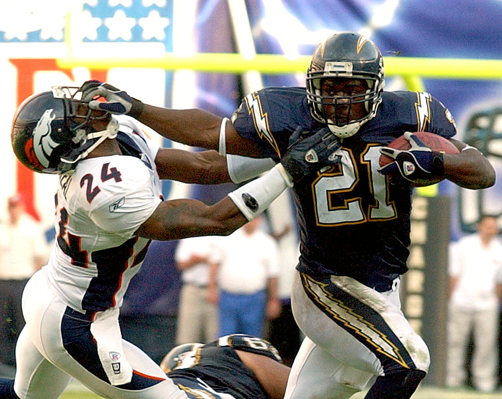 San Diego Charger LaDainian Tomlinson (R) fends of