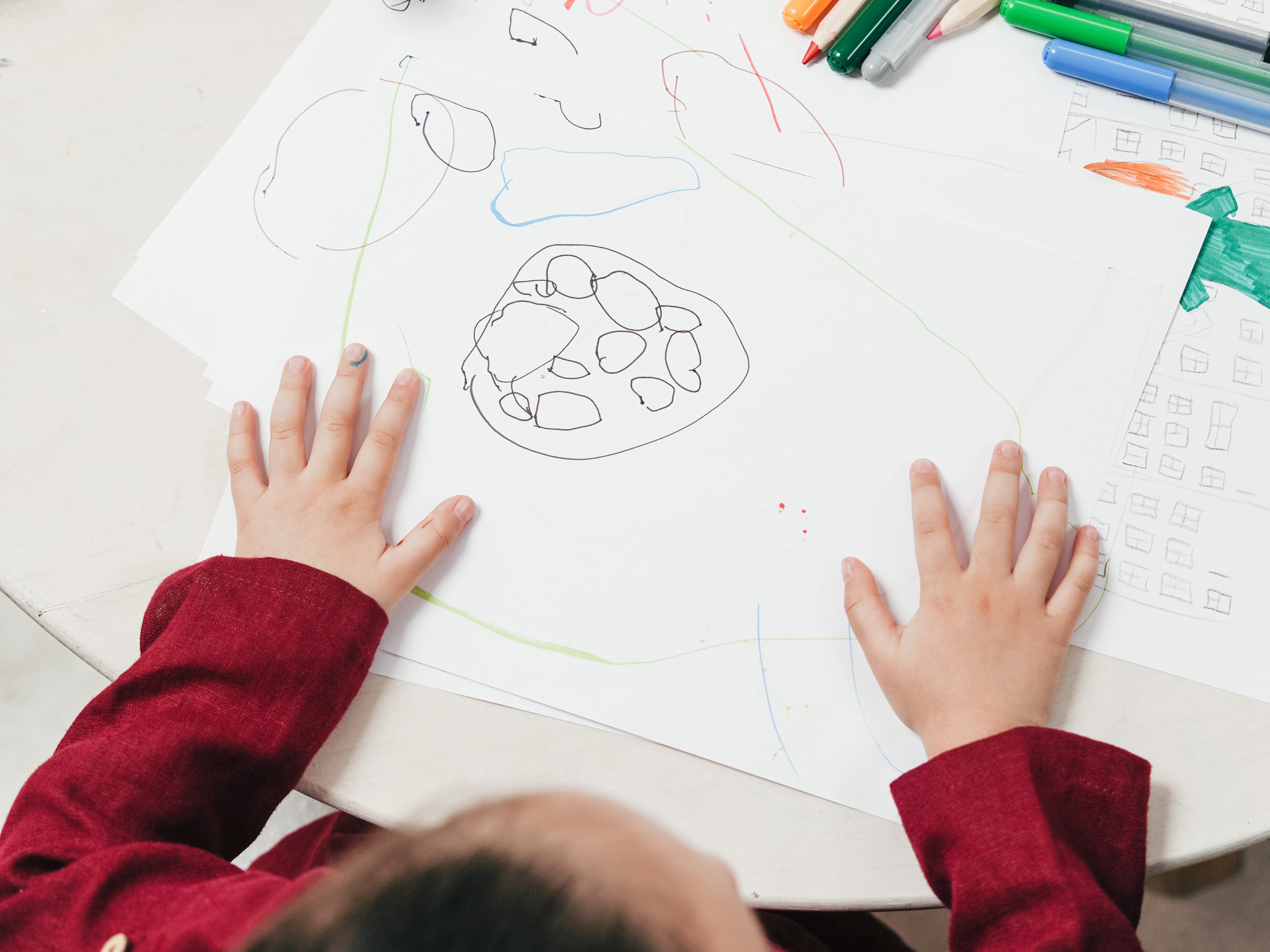 High angle photo of a child drawing.