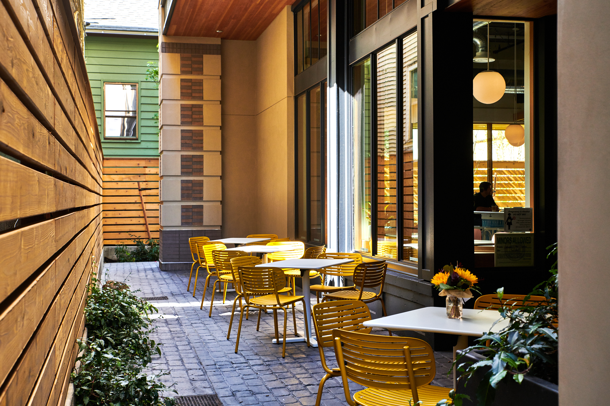 A picture of the small, long patio seating at Bar Diane