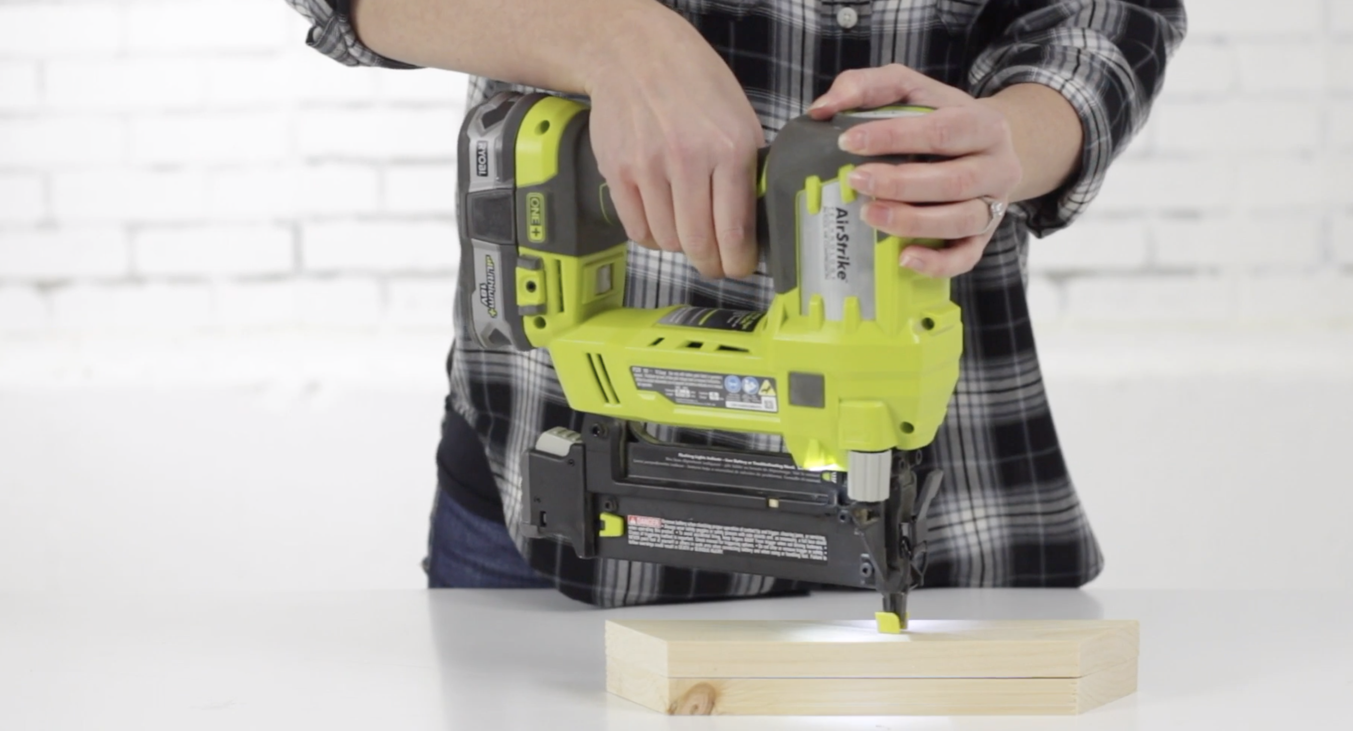 Jenn Largesse demonstrates how to use a pneumatic nailer.
