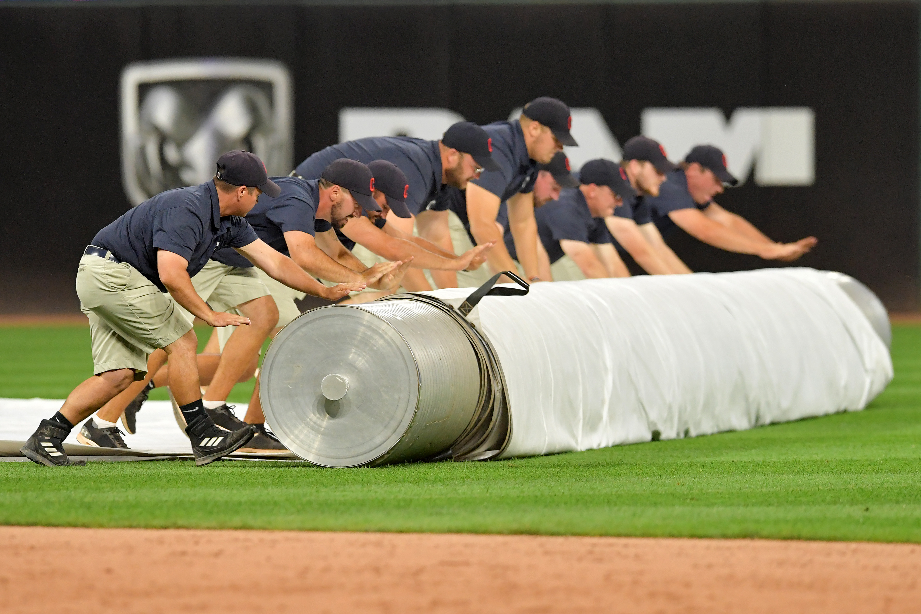 The Cleveland Indians grounds crew rolls out the tarp in preparation for a rain delay during the second inning of the game against the Minnesota Twins at Progressive Field on September 13, 2019 in Cleveland, Ohio.