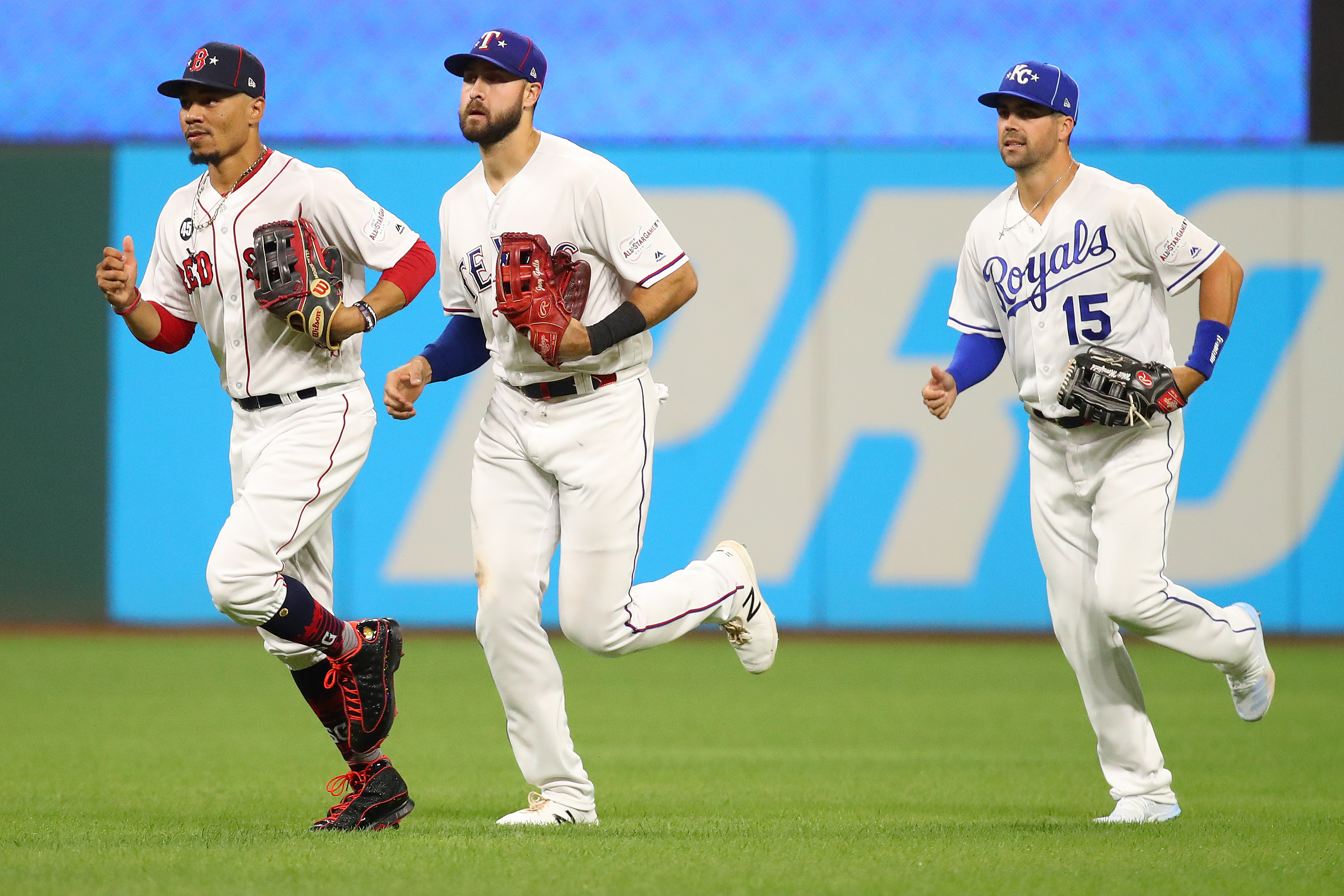 Mookie Betts #50 of the Boston Red Sox, Joey Gallo #13 of the Texas Rangers and Whit Merrifield #15 of the Kansas City Royals during the 2019 MLB All-Star Game at Progressive Field on July 09, 2019 in Cleveland, Ohio.
