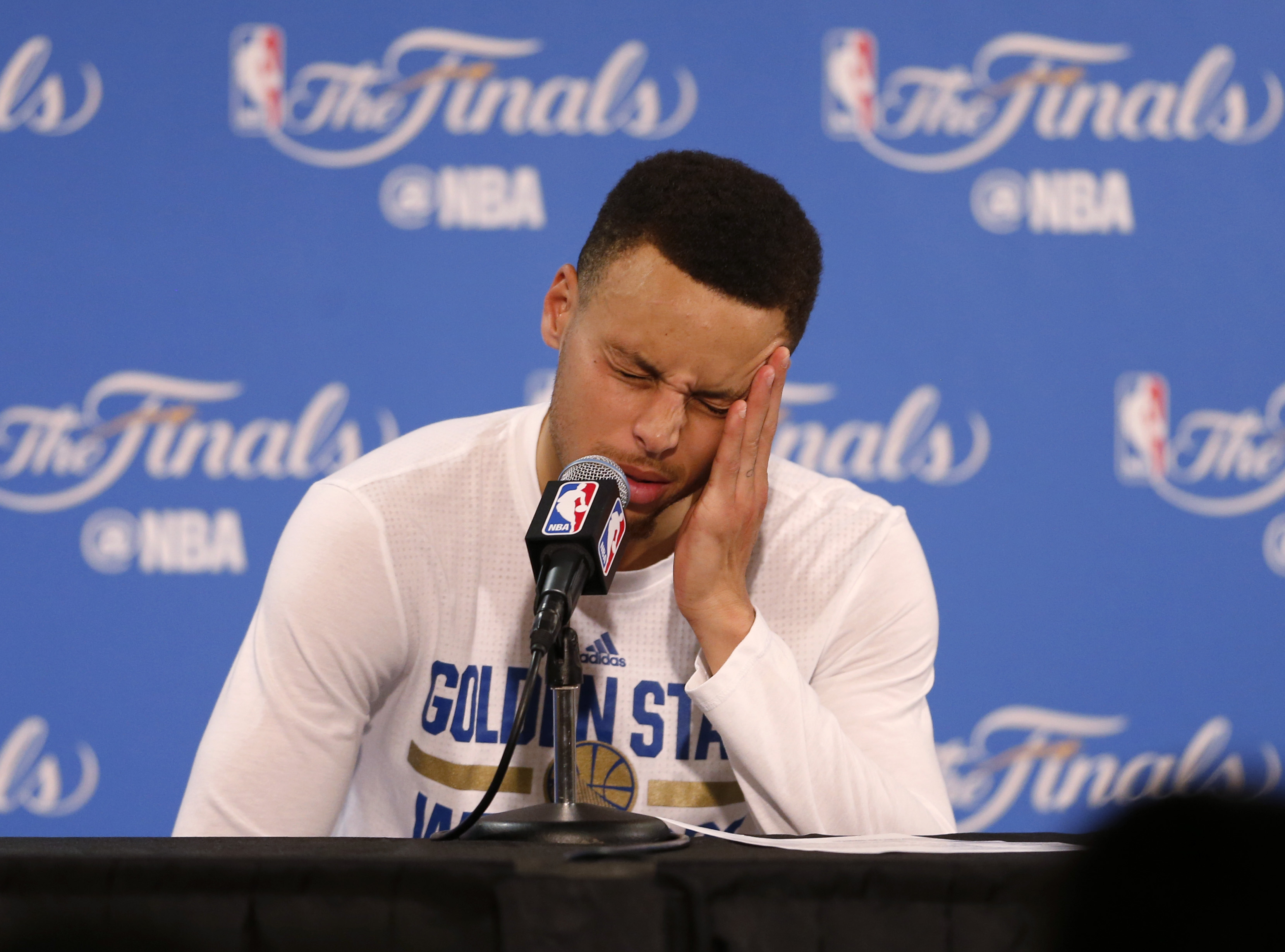Golden State Warriors' Stephen Curry (30) answers questions during a press conference after the Cleveland Cavaliers beat the Warriors in Game 7 93-89 for the NBA Finals at Oracle Arena in Oakland, Calif., on Sunday, June 19, 2016. (Nhat V. Meyer/Bay Area