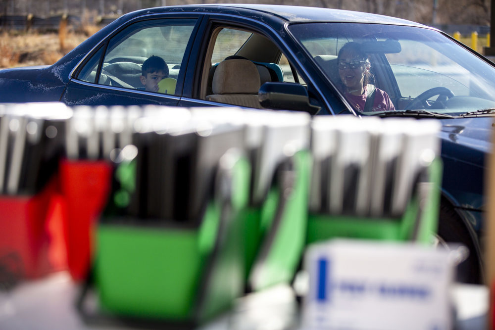 Kylie Dennison drives up to Joe Shoemaker School to get a laptop for her son as Denver students prepare for remote learning.