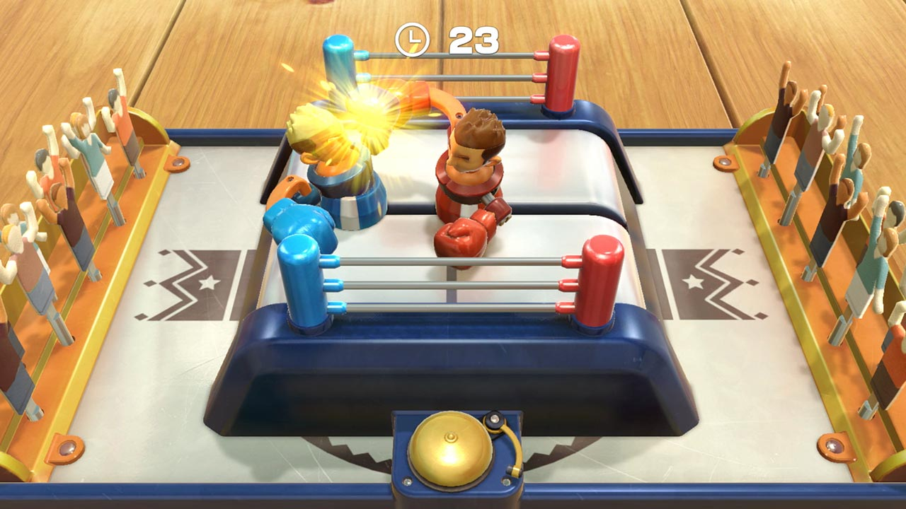 Two toy boxers face off in the ringt