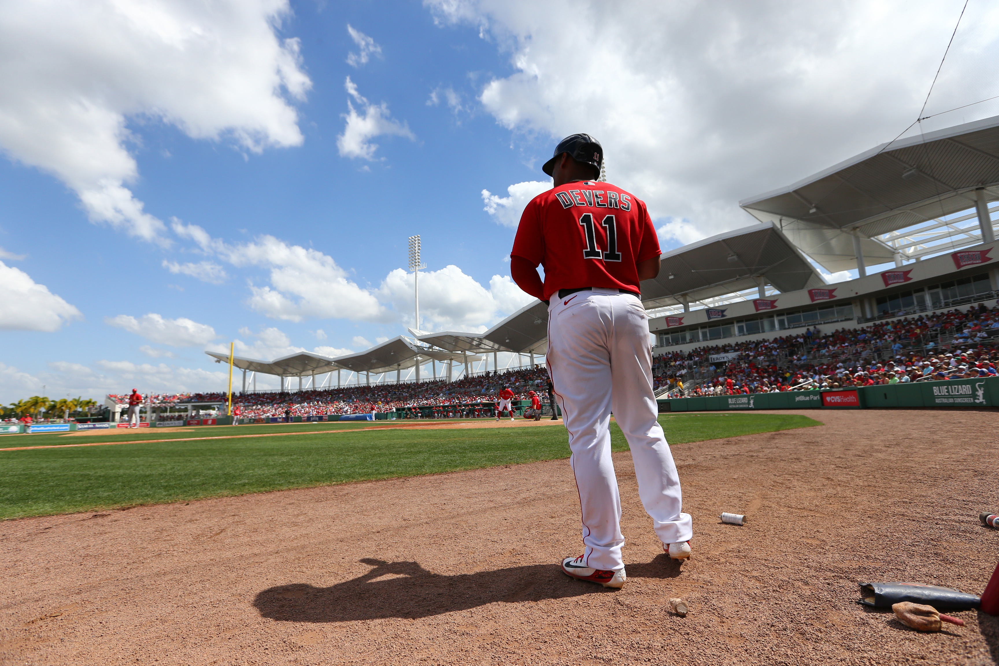 Boston Red Sox third baseman Rafael Devers (11) on deck to bat during the fourth inning against the St. Louis Cardinals at JetBlue Park.
