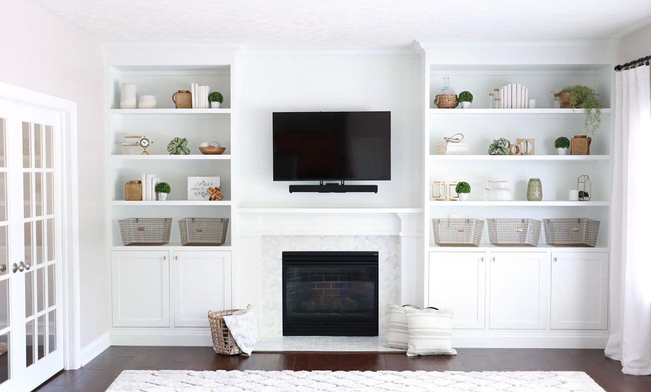 Custom shelving unit around a fireplace