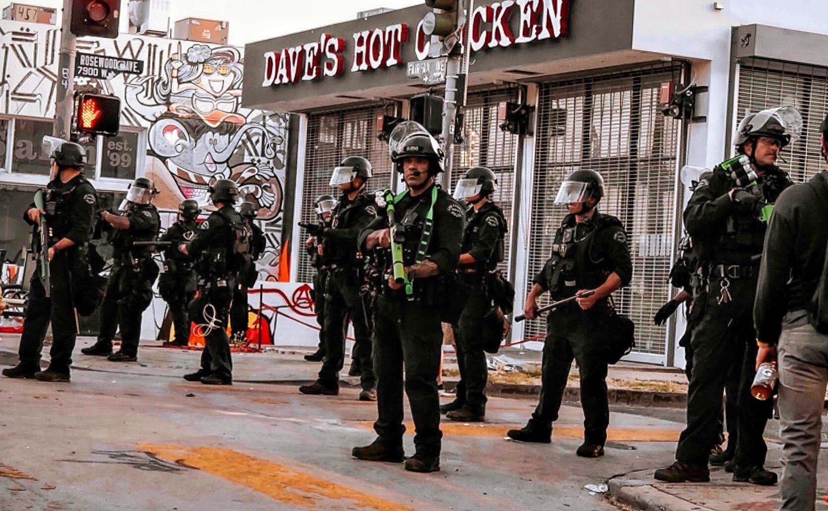 Police stand watch over Fairfax District in front of forthcoming restaurant Dave's Hot Chicken