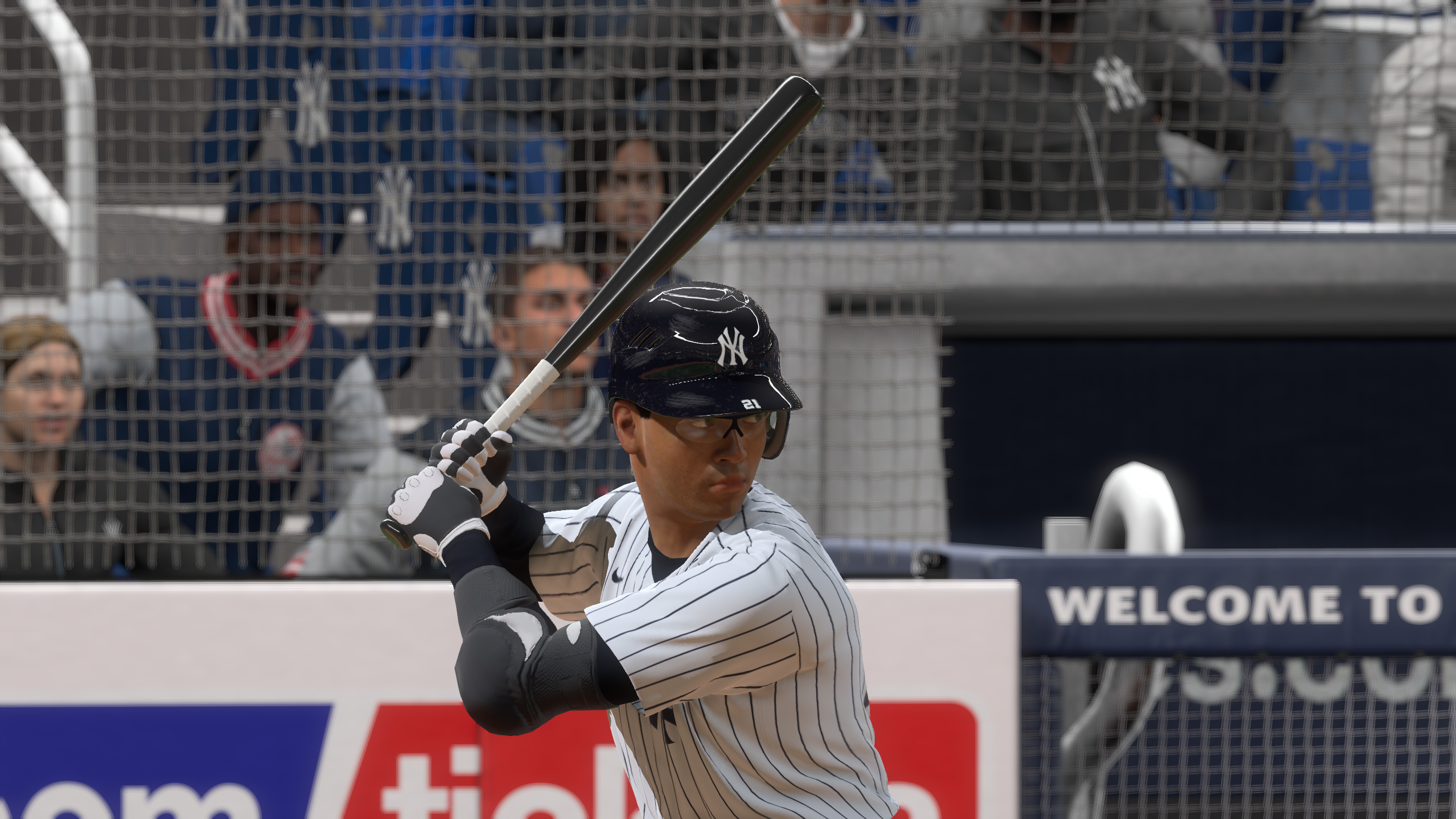 a close-up of a brown-skinned man wearing a New York Yankees jersey awaiting a pitch at Yankee Stadium in a night game in MLB The Show 20