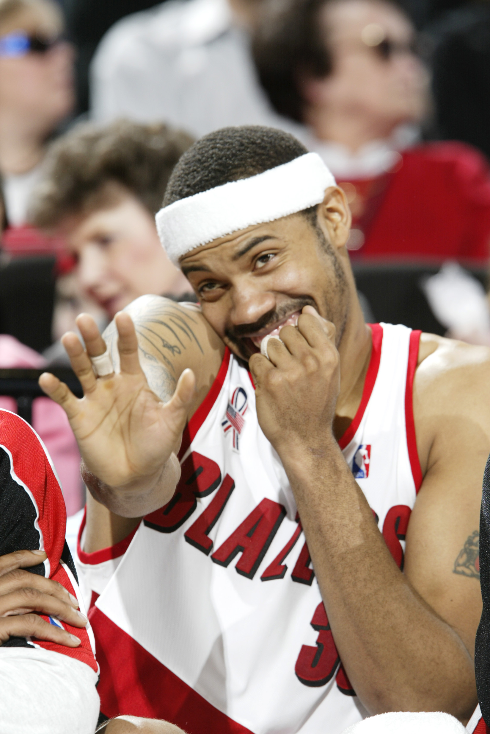 Rasheed Wallace smiles and waves on the bench