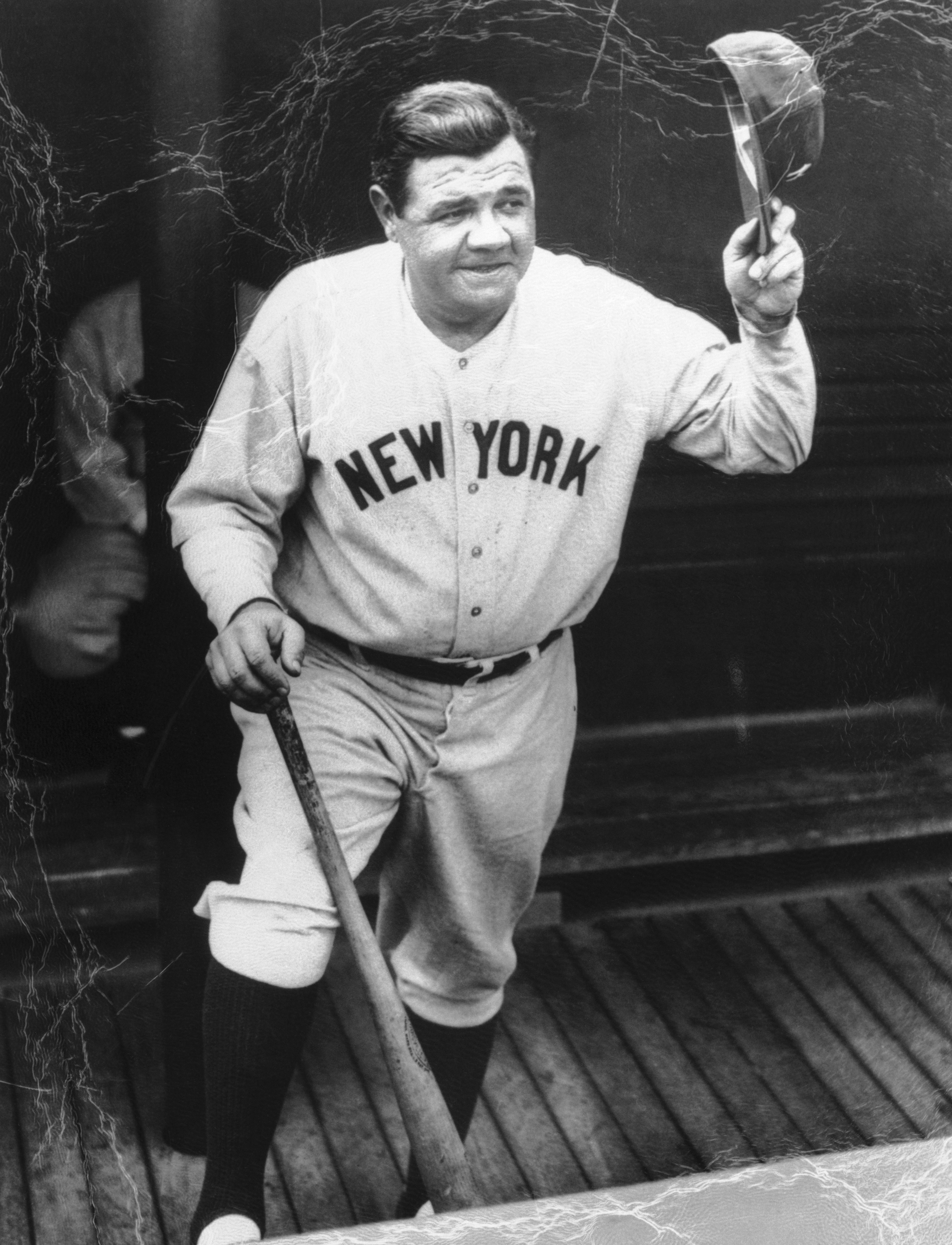 Babe Ruth Waving Hat in Dugout