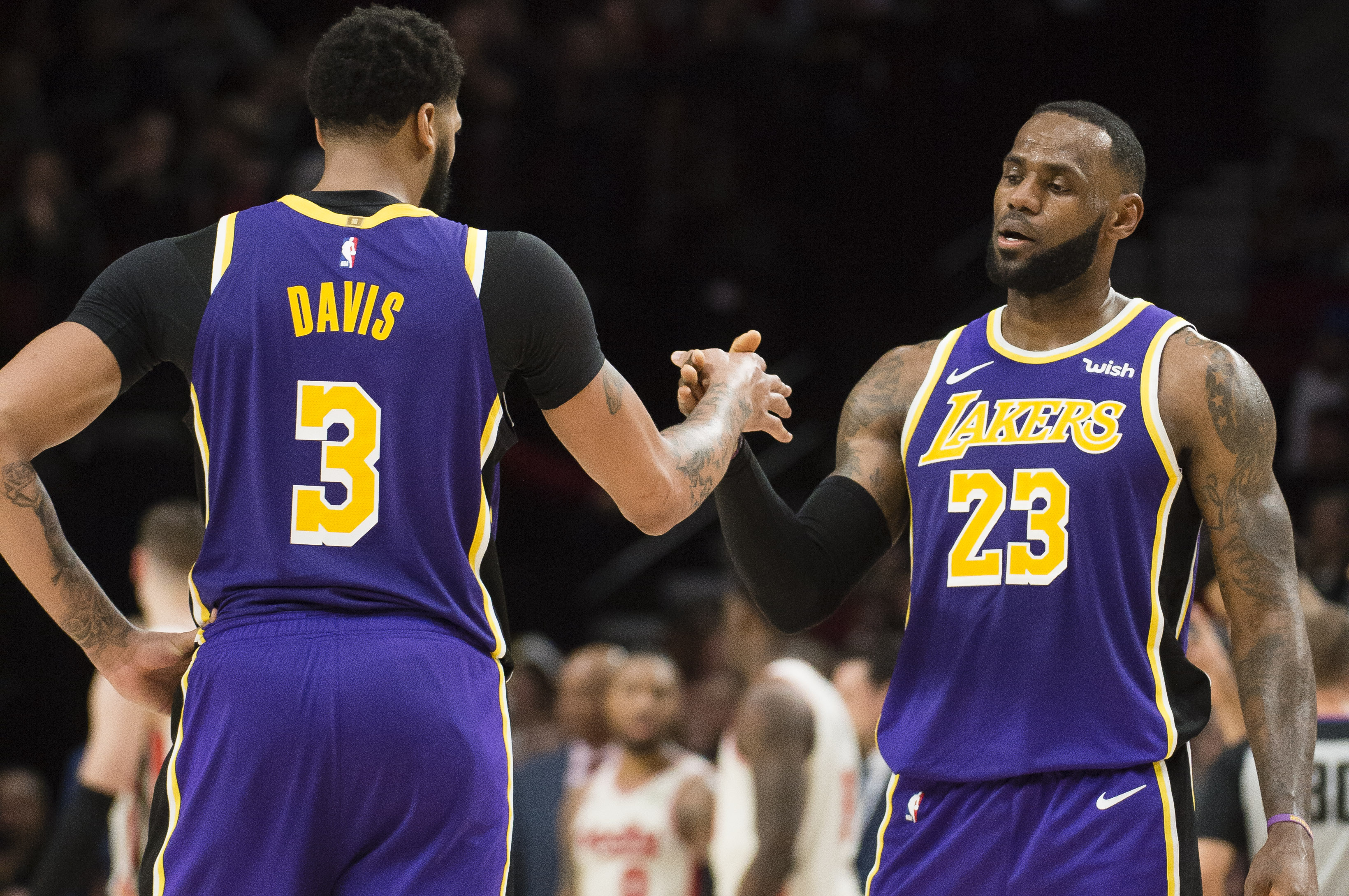 Los Angeles Lakers forward Anthony Davis and forward LeBron James celebrate late in the second half against the Portland Trail Blazers at Moda Center. The Los Angeles Lakers beat the Portland Trail Blazers 136-113.