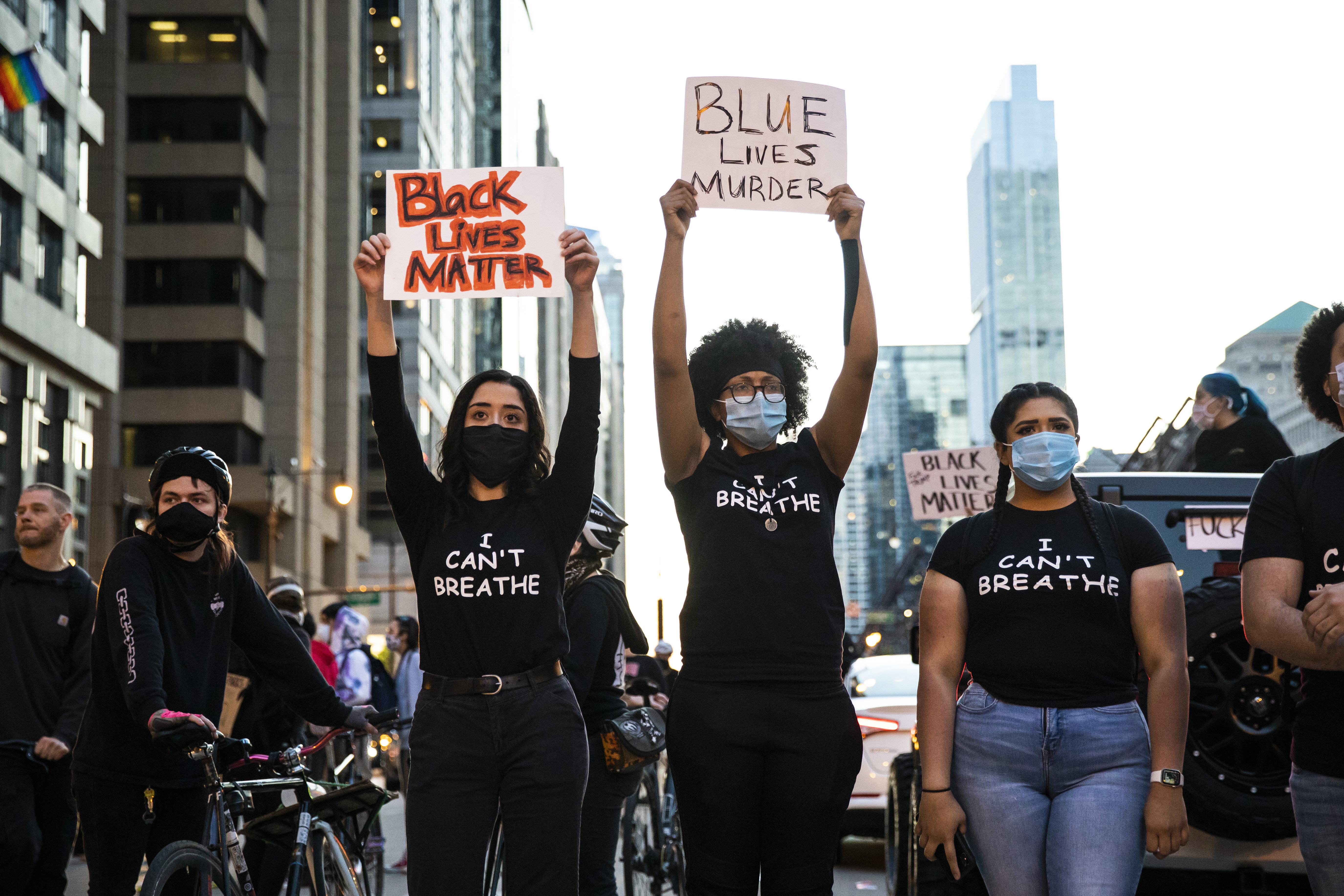 Protesters hold placards in Chicago in May of 2020 as they join national outrage over the death of George Floyd.