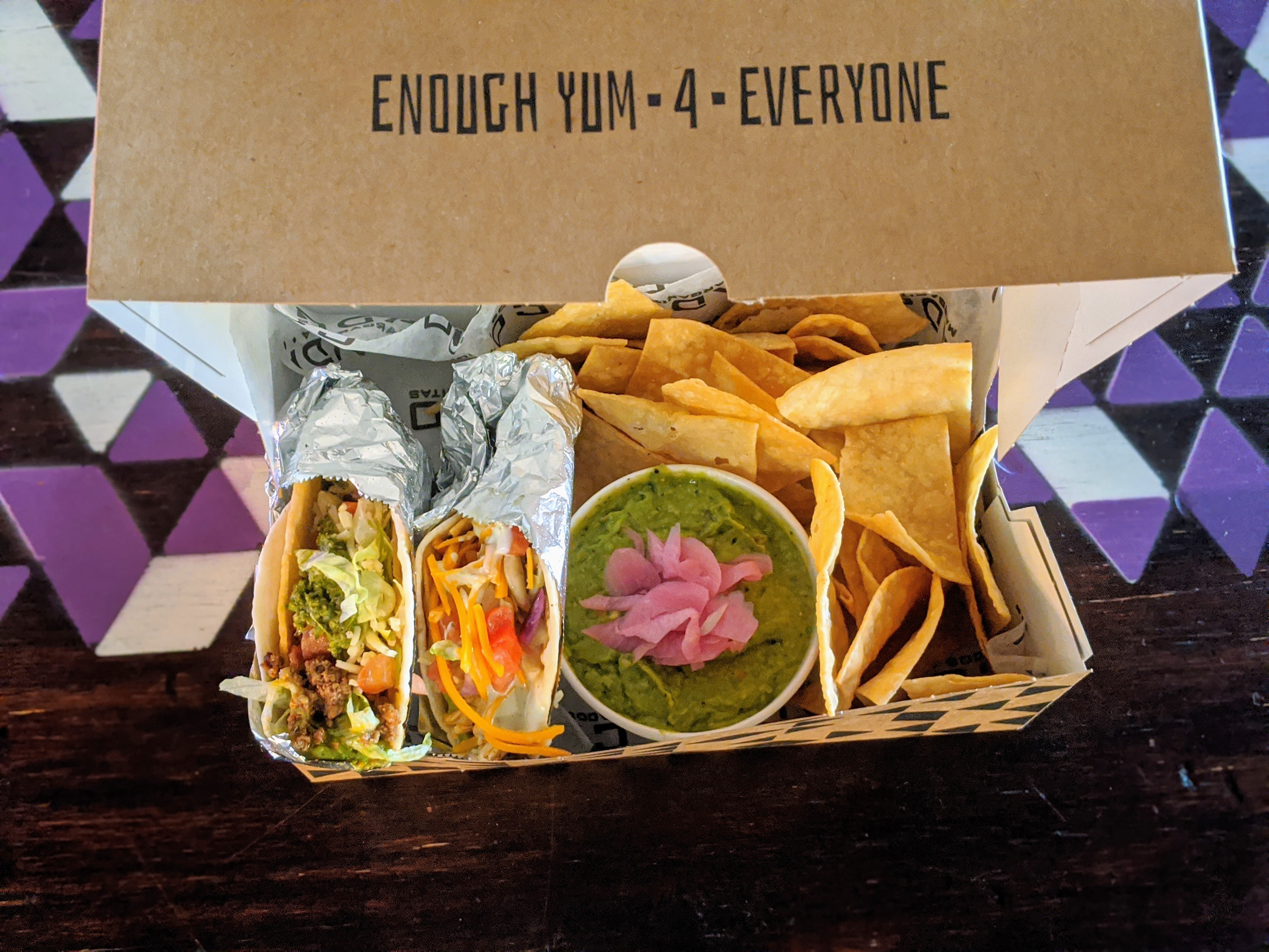 A Bud Box from Condado Tacos is filled with gaucamole, tacos, and corn chips.