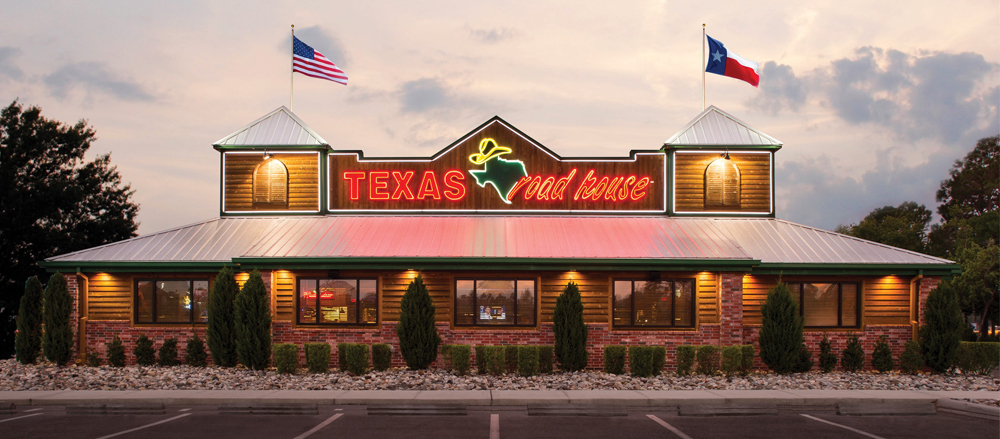 The exterior of the faux-rustic, flag-waving, Western-themed Texas Roadhouse, headed to Henderson.
