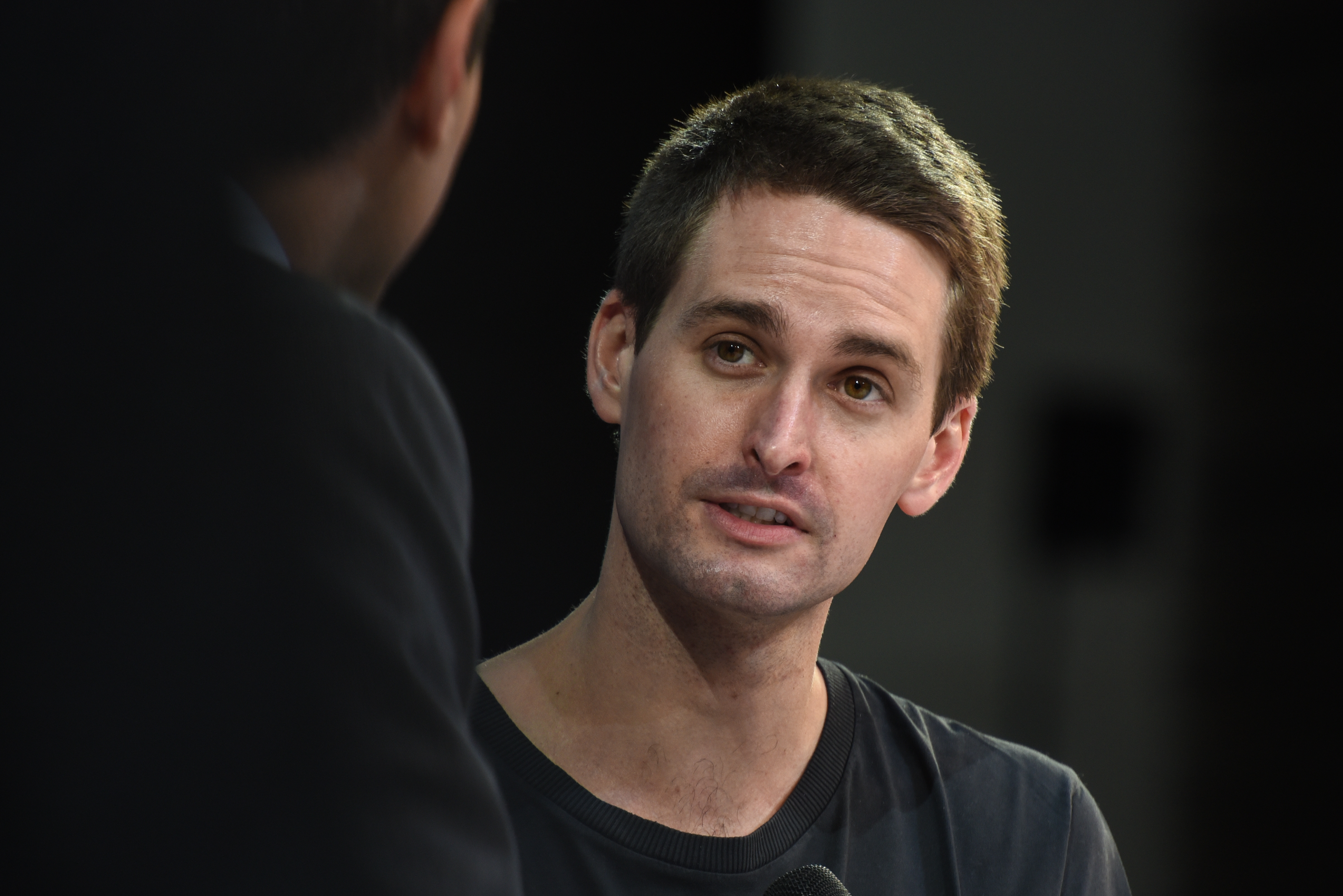 Evan Spiegel speaks onstage in 2018.