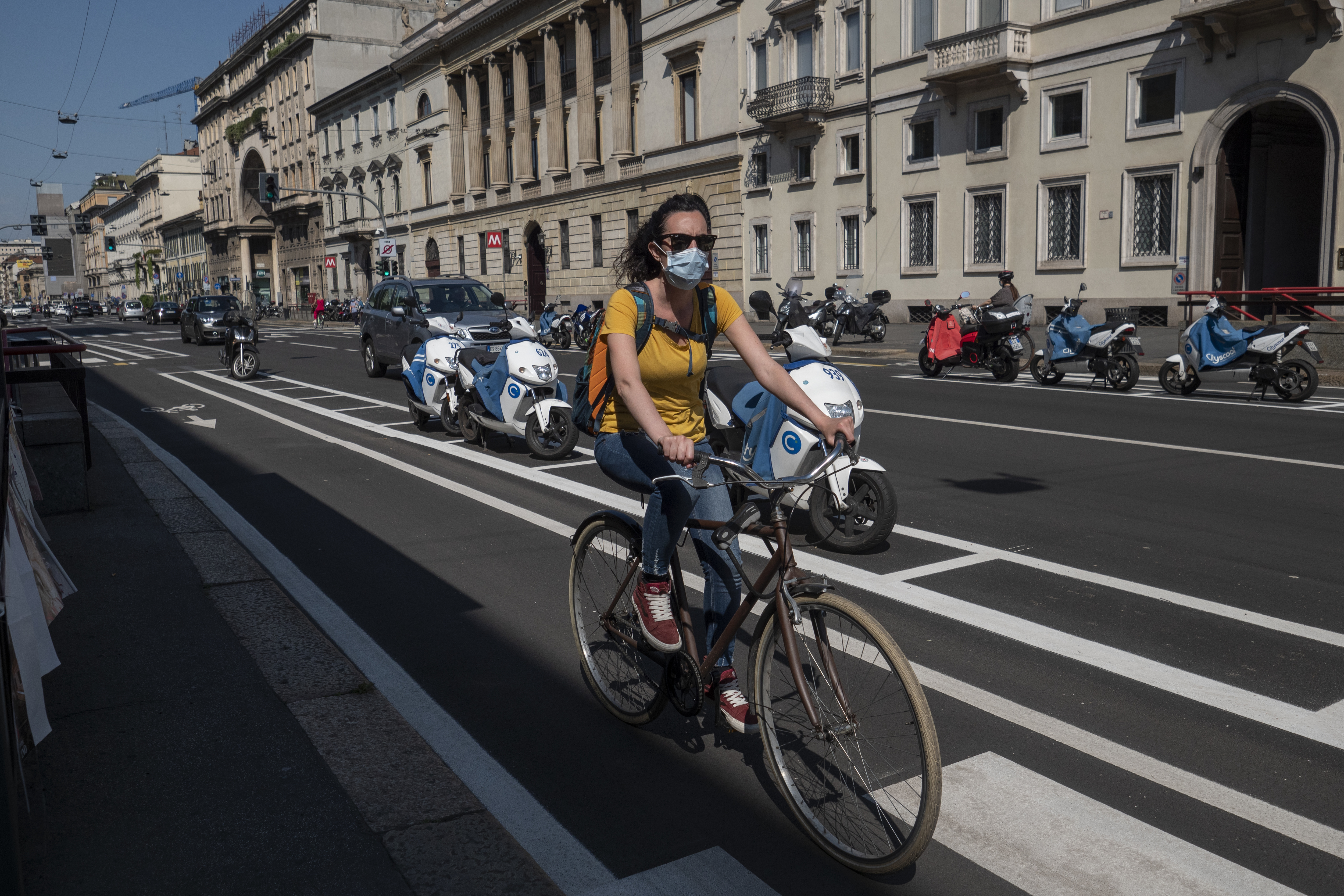 A cyclist rides in a new bike lane in Milan, Italy.
