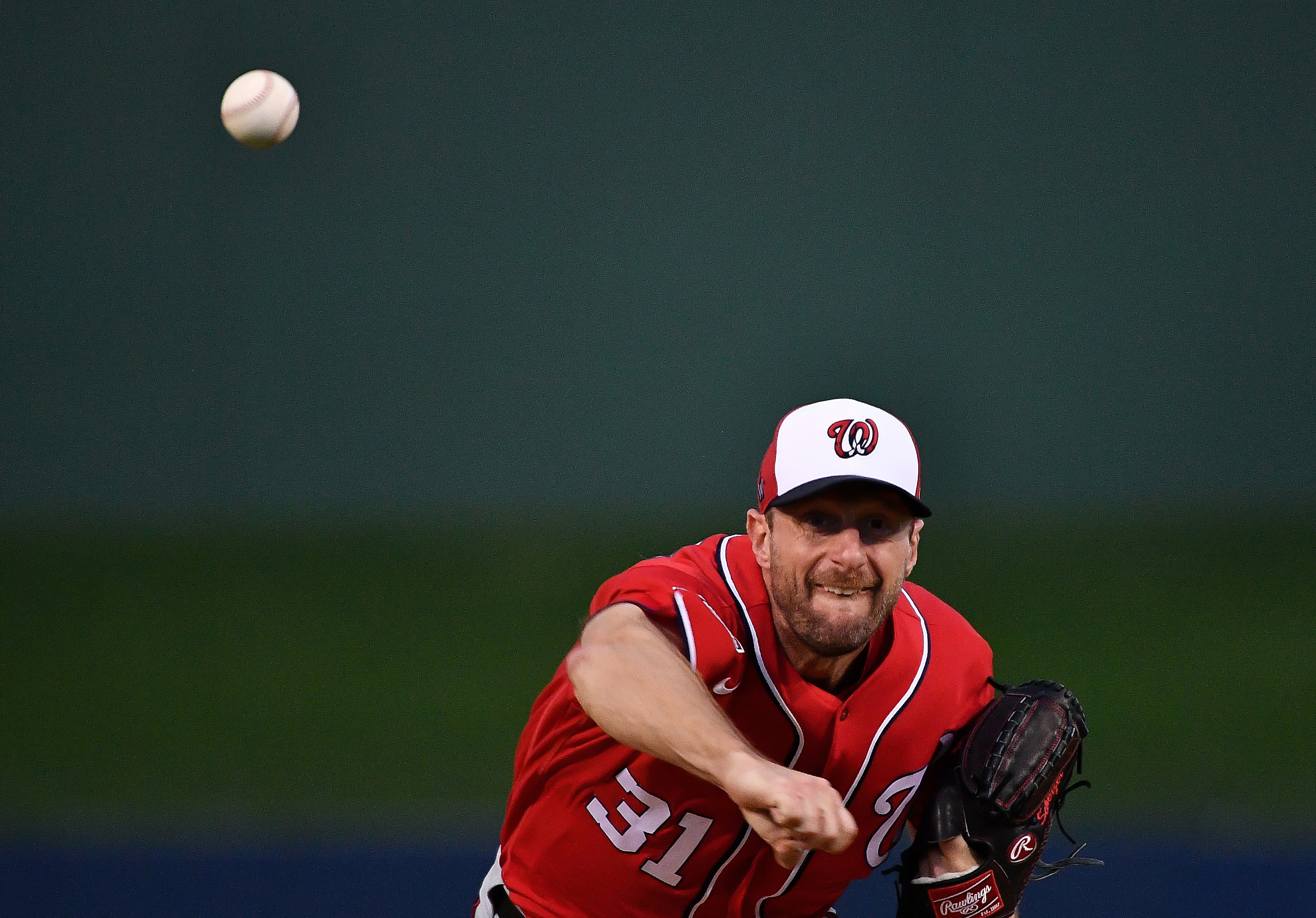 Max Scherzer #31 of the Washington Nationals delivers a pitch during the spring training game against the Houston Astros at FITTEAM Ballpark of the Palm Beaches on February 22, 2020 in West Palm Beach, Florida.