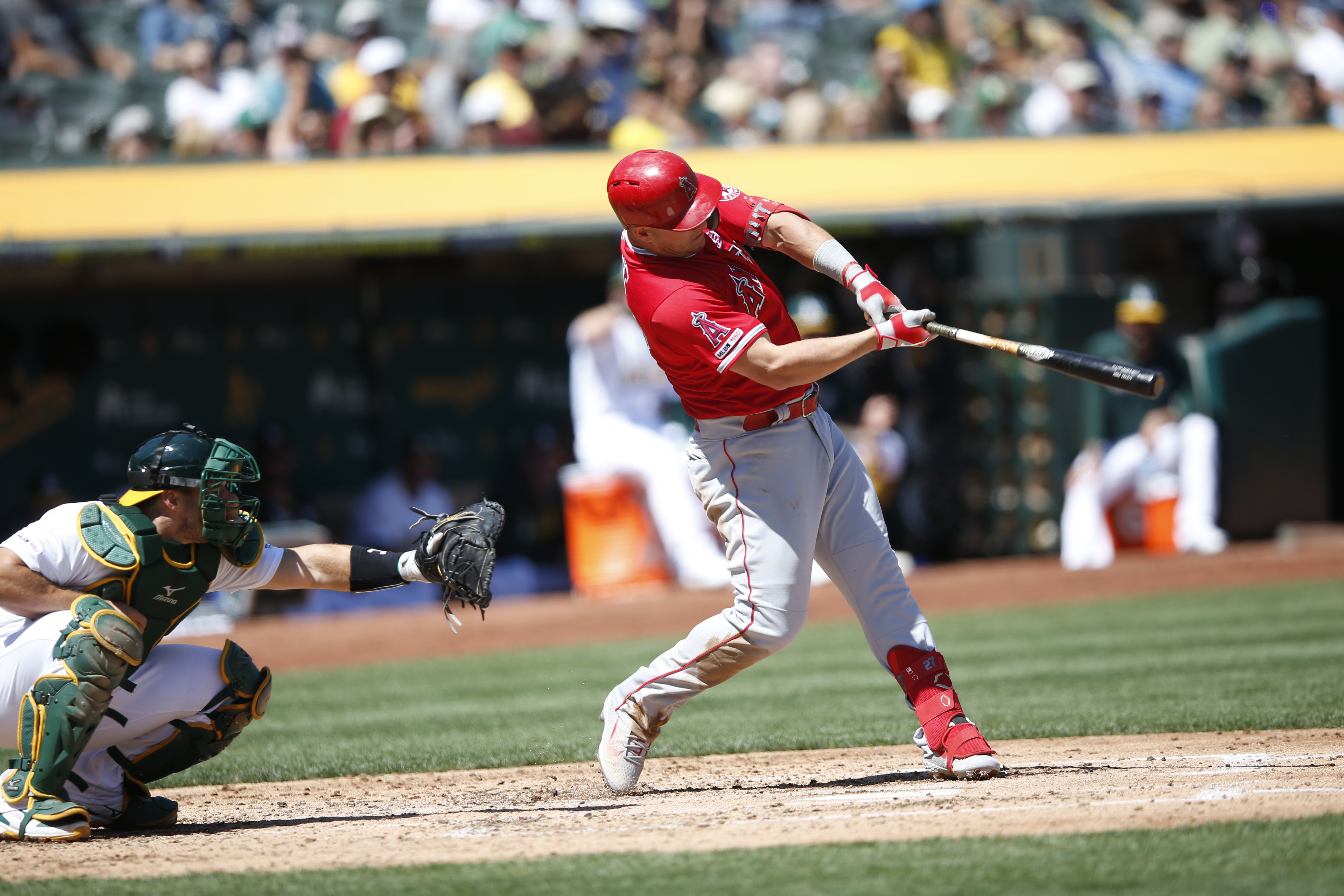 Mike Trout #27 of the Los Angeles Angels of Anaheim hits a home run during the game against the Oakland Athletics at the Oakland-Alameda County Coliseum on September 5, 2019 in Oakland, California. The Athletics defeated the Angels 10-6.
