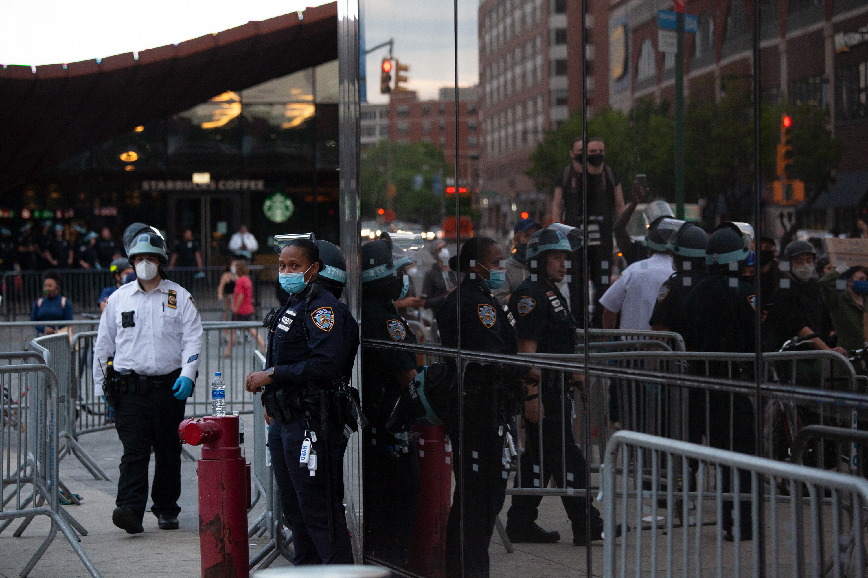 NYPD officers stand guard at the Barclays Center.