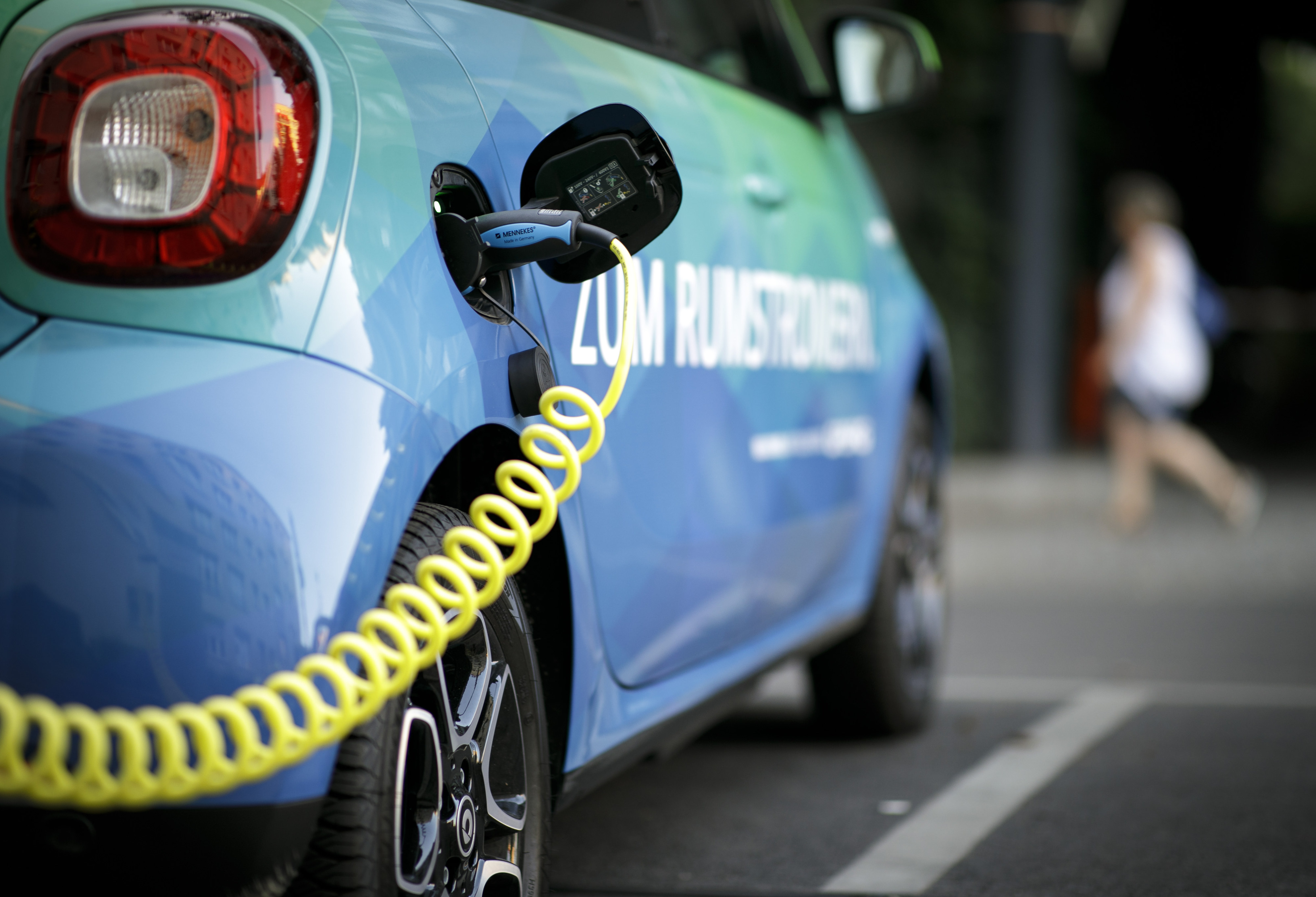 An electric car charges in Germany