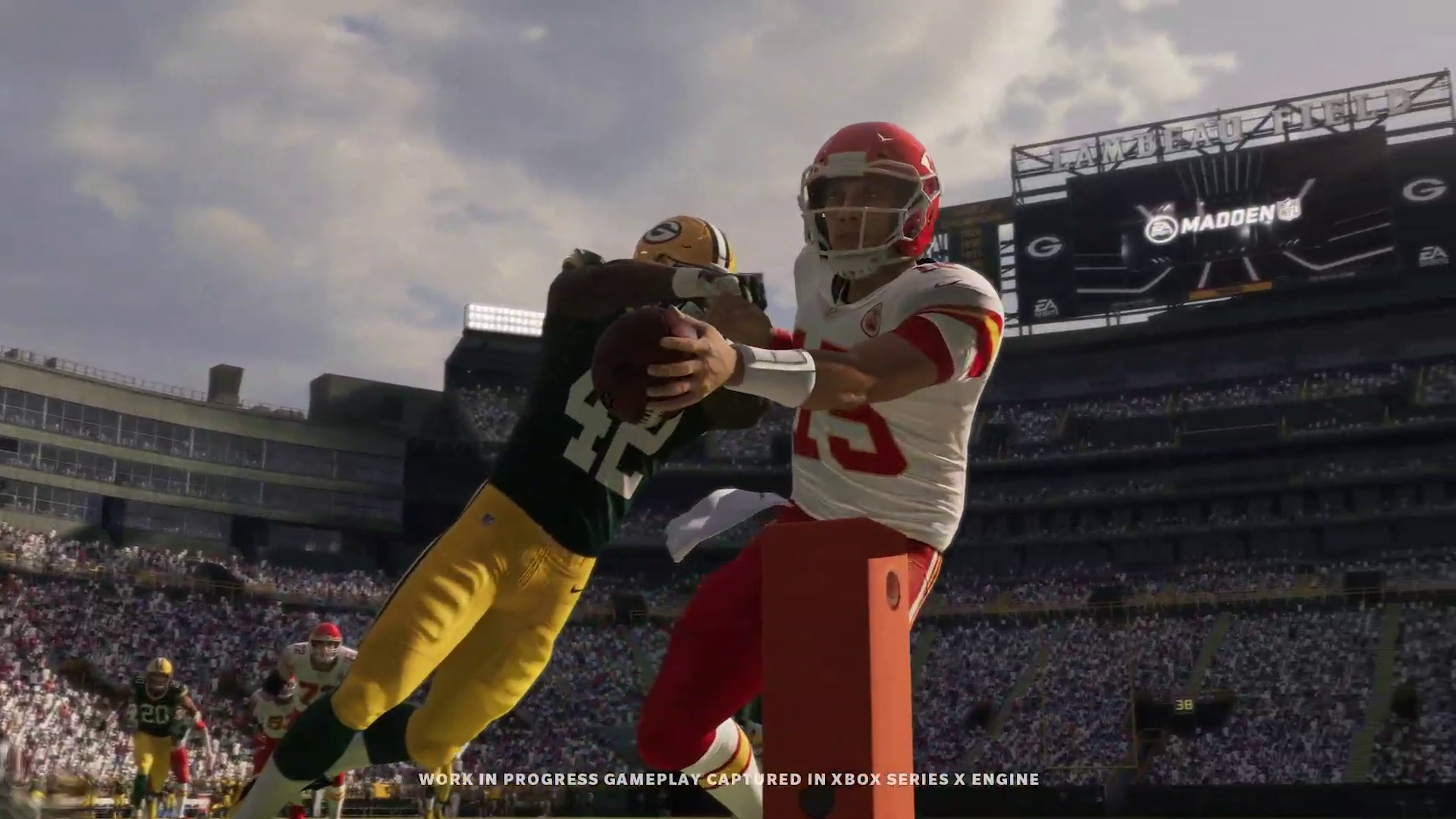 the Chiefs' Patrick Mahomes carries the ball over the pylon while getting tackled in Madden NFL 21