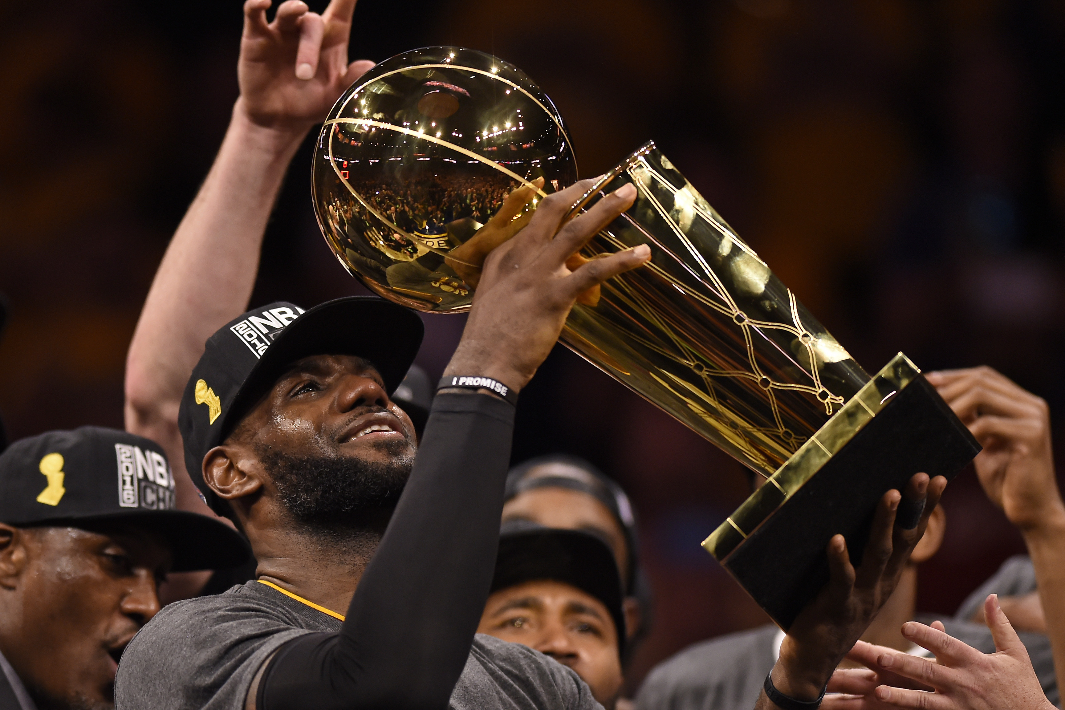 Cleveland Cavaliers' LeBron James (23) holds up the Larry O'Brien trophy after defeating the Golden State Warriors in Game 7 of the NBA Finals at Oracle Arena in Oakland, Calif., on Sunday, June 19, 2016. The Cleveland Cavaliers defeated the Golden State