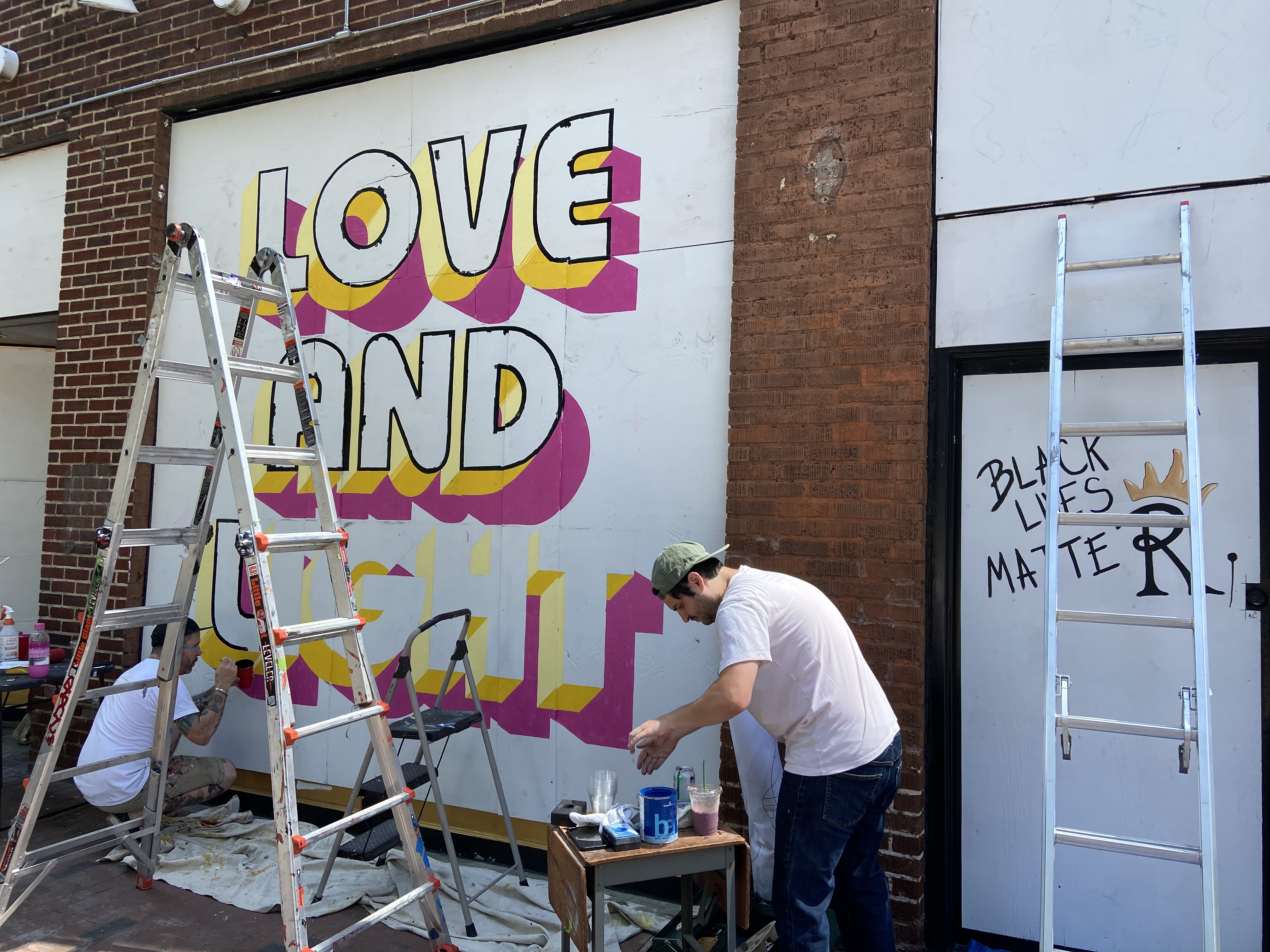 Murals painted on boarded up walls at Royale in downtown Raleigh