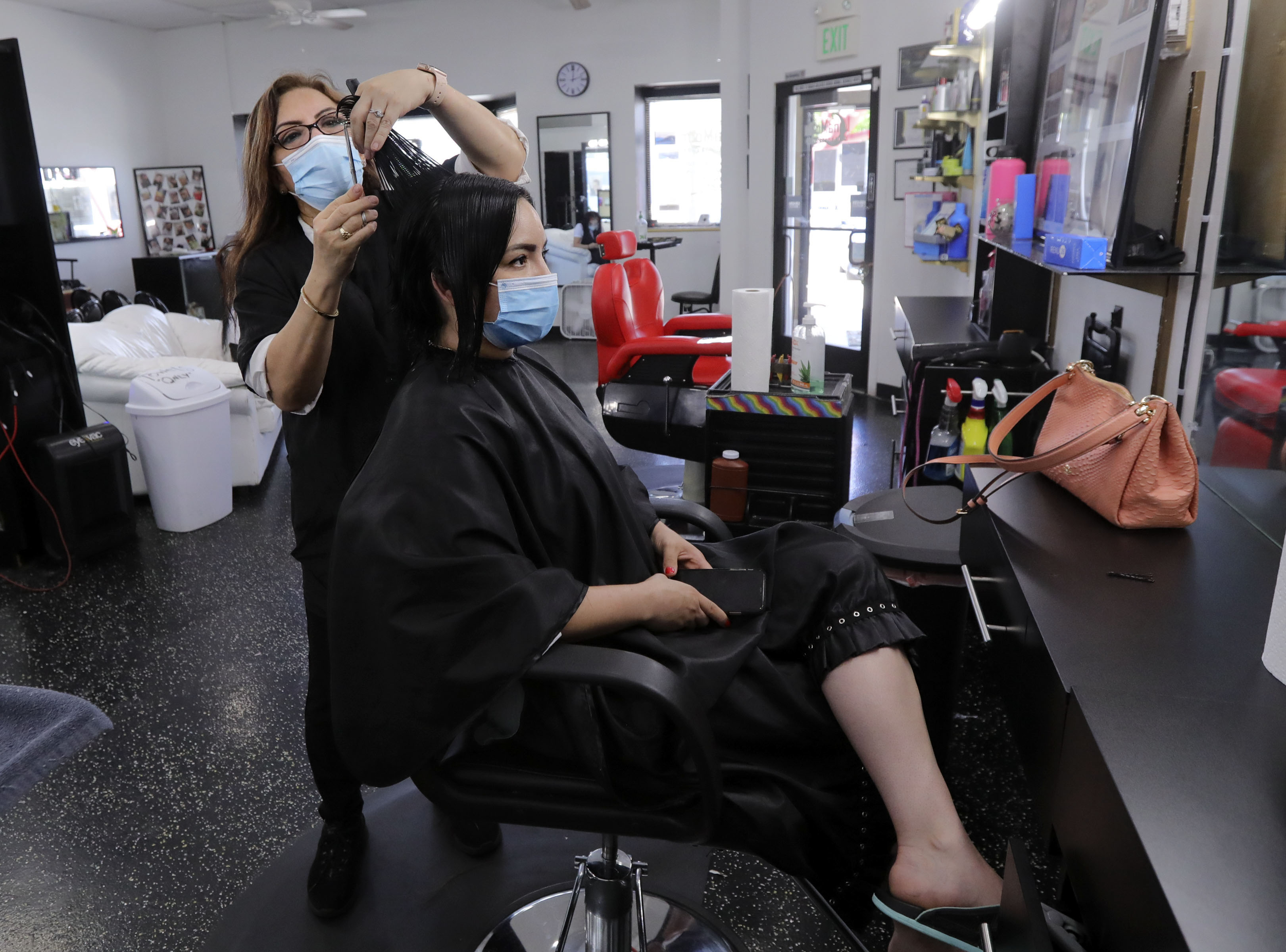 Violet Campos, owner of LunaMoon Salon and Barbershop, gives Lily Pinon a haircut at her shop in Taylorsville on Thursday, June 11, 2020. Campos applied for COVID-19 relief grants but said she was denied because her business was too small.