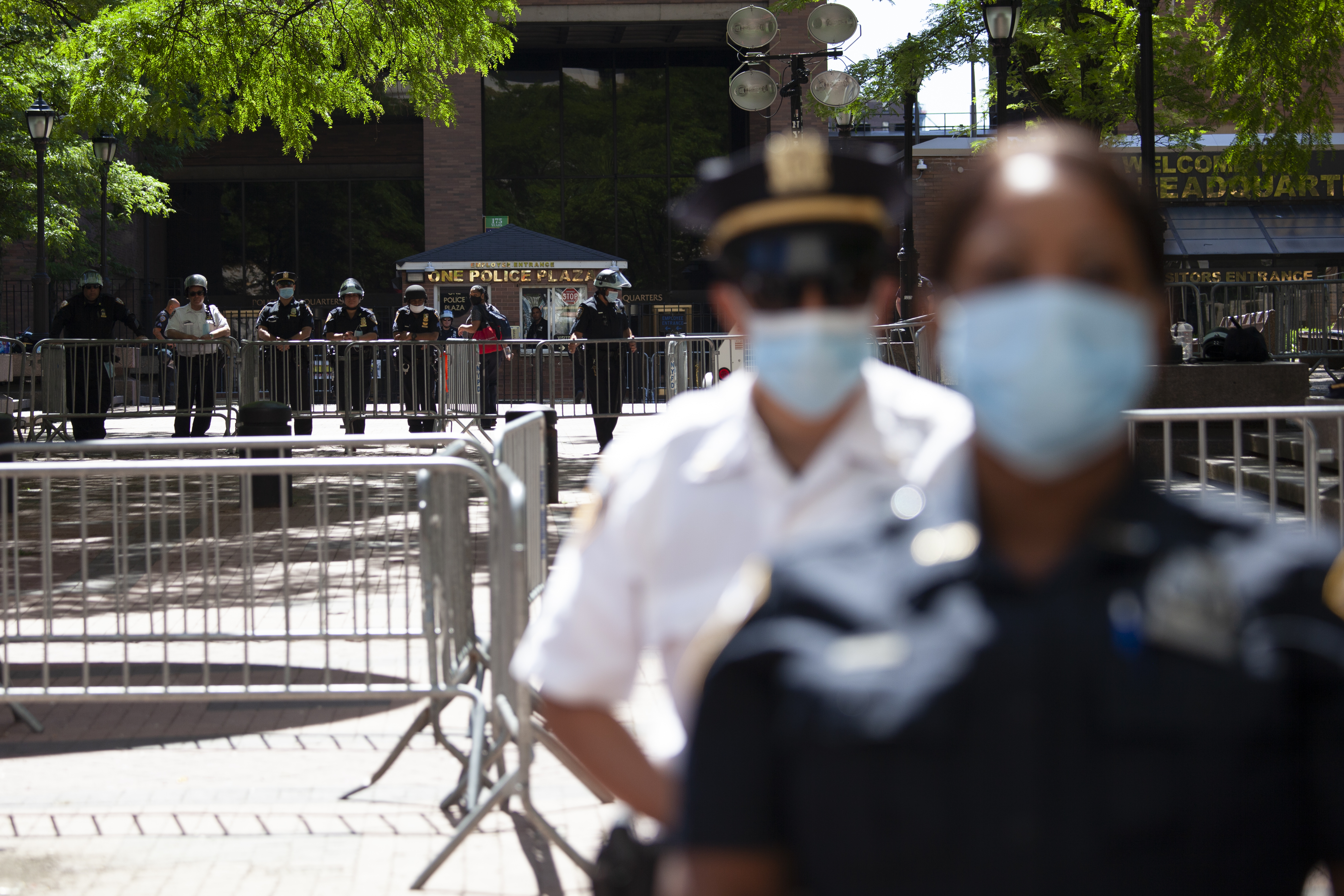 NYPD officers stand guard outside One Police Plaza during a protest by City Hall workers, June 8, 2020.