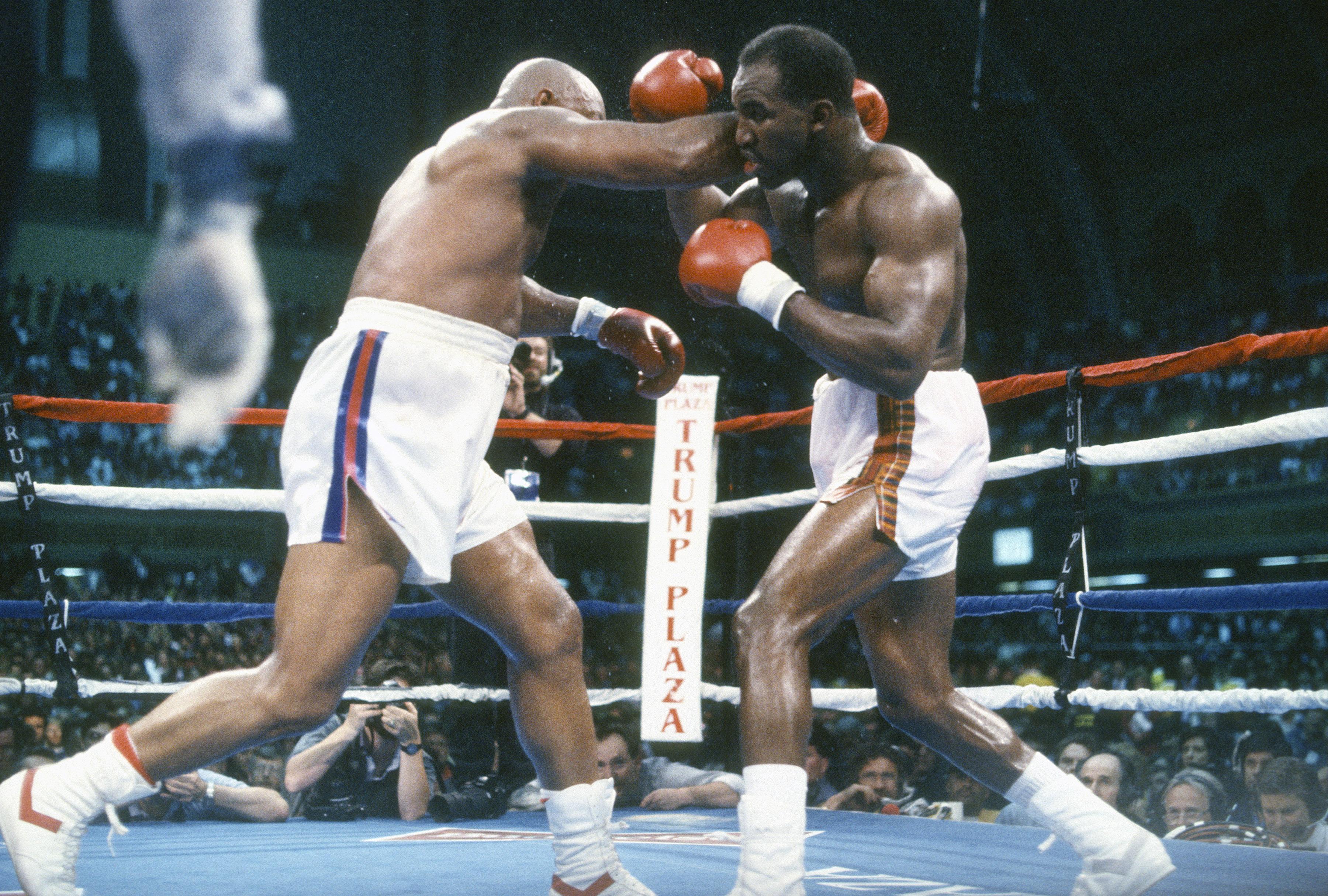 WBC, WBA and IBF Heavyweight Tittle Fight - Evander Holyfield v George Foreman