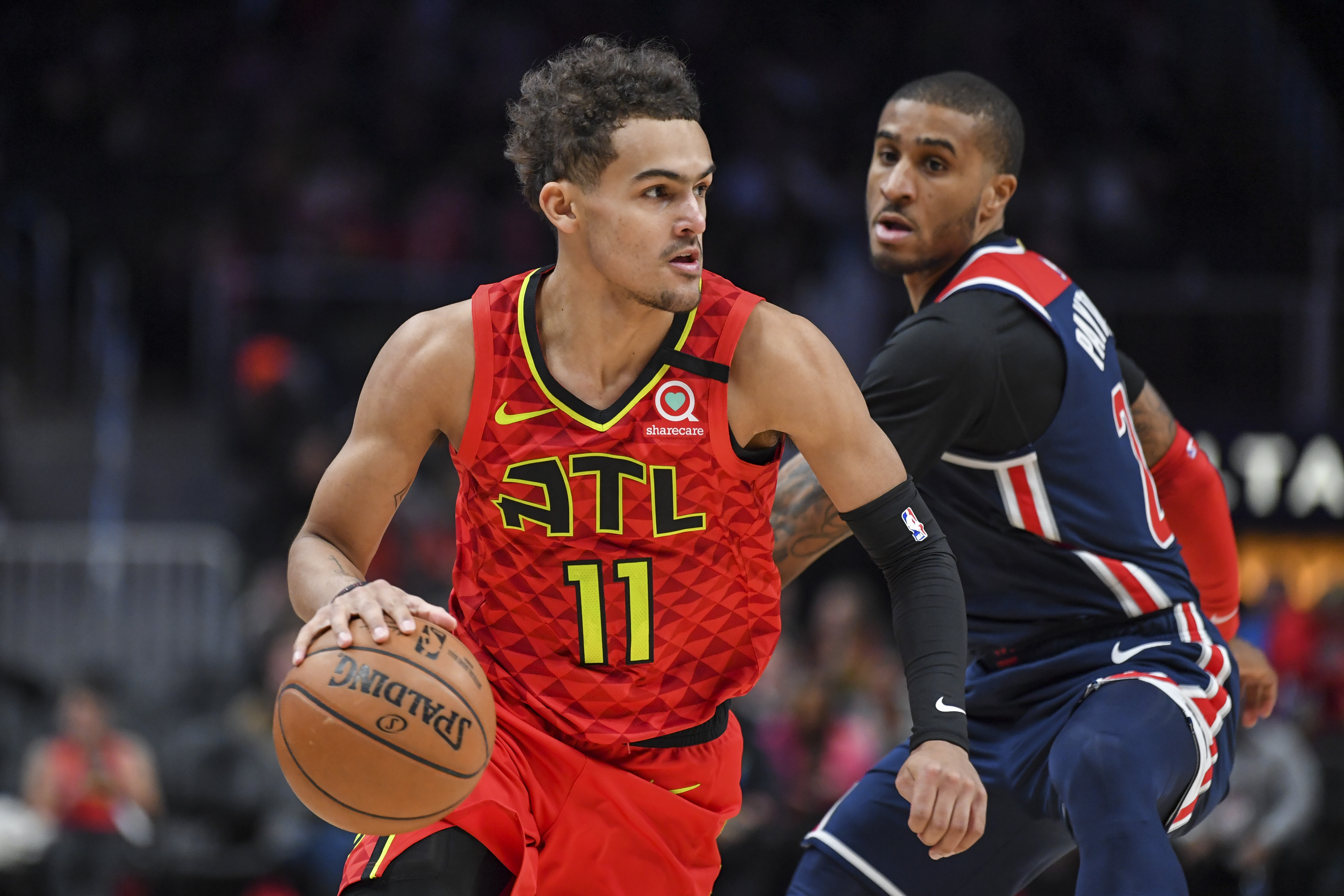 Atlanta Hawks guard Trae Young dribbles the ball past Washington Wizards guard Gary Payton II during the second half at State Farm Arena.