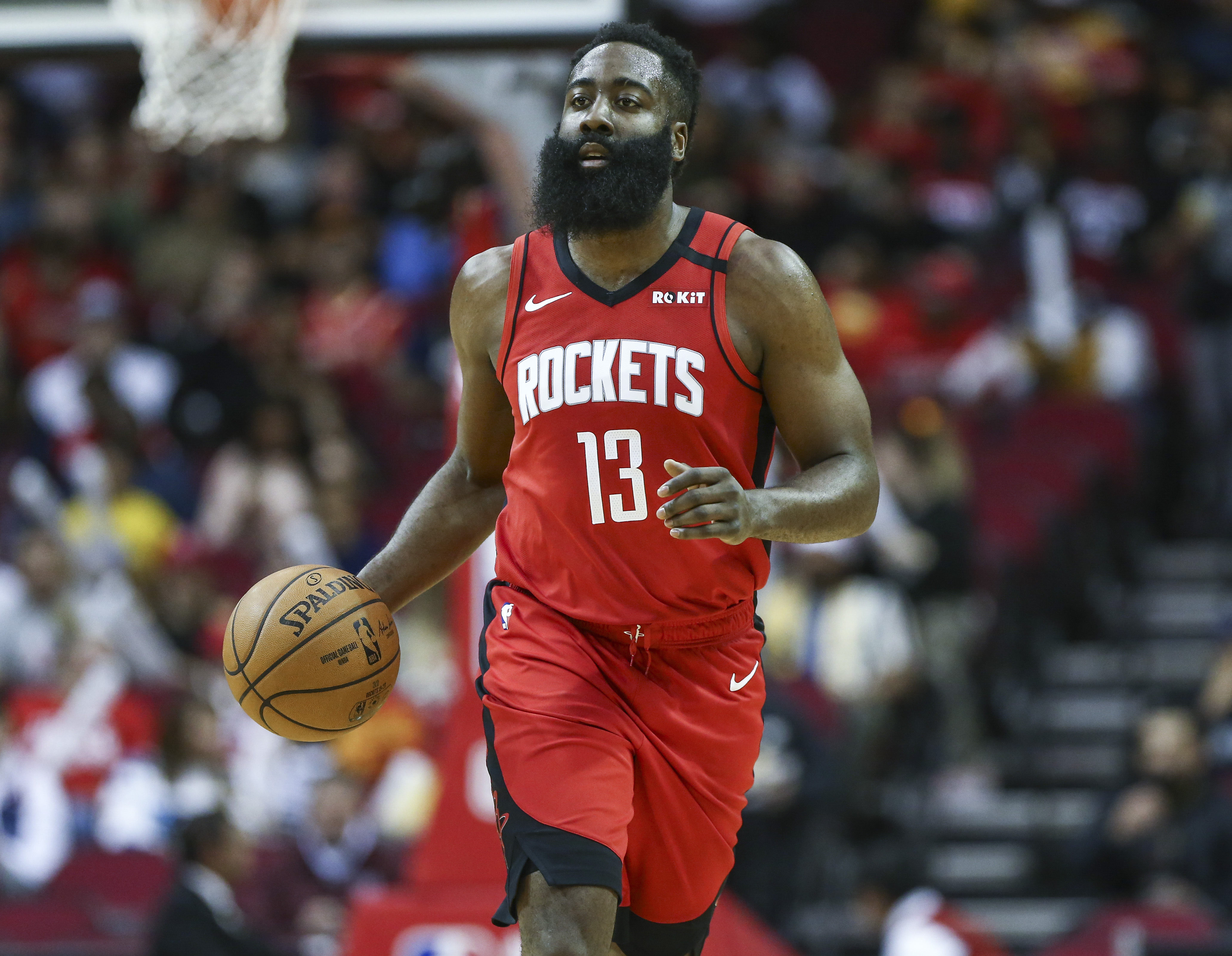 Houston Rockets guard James Harden dribbles the ball during the first quarter against the Los Angeles Clippers at Toyota Center.