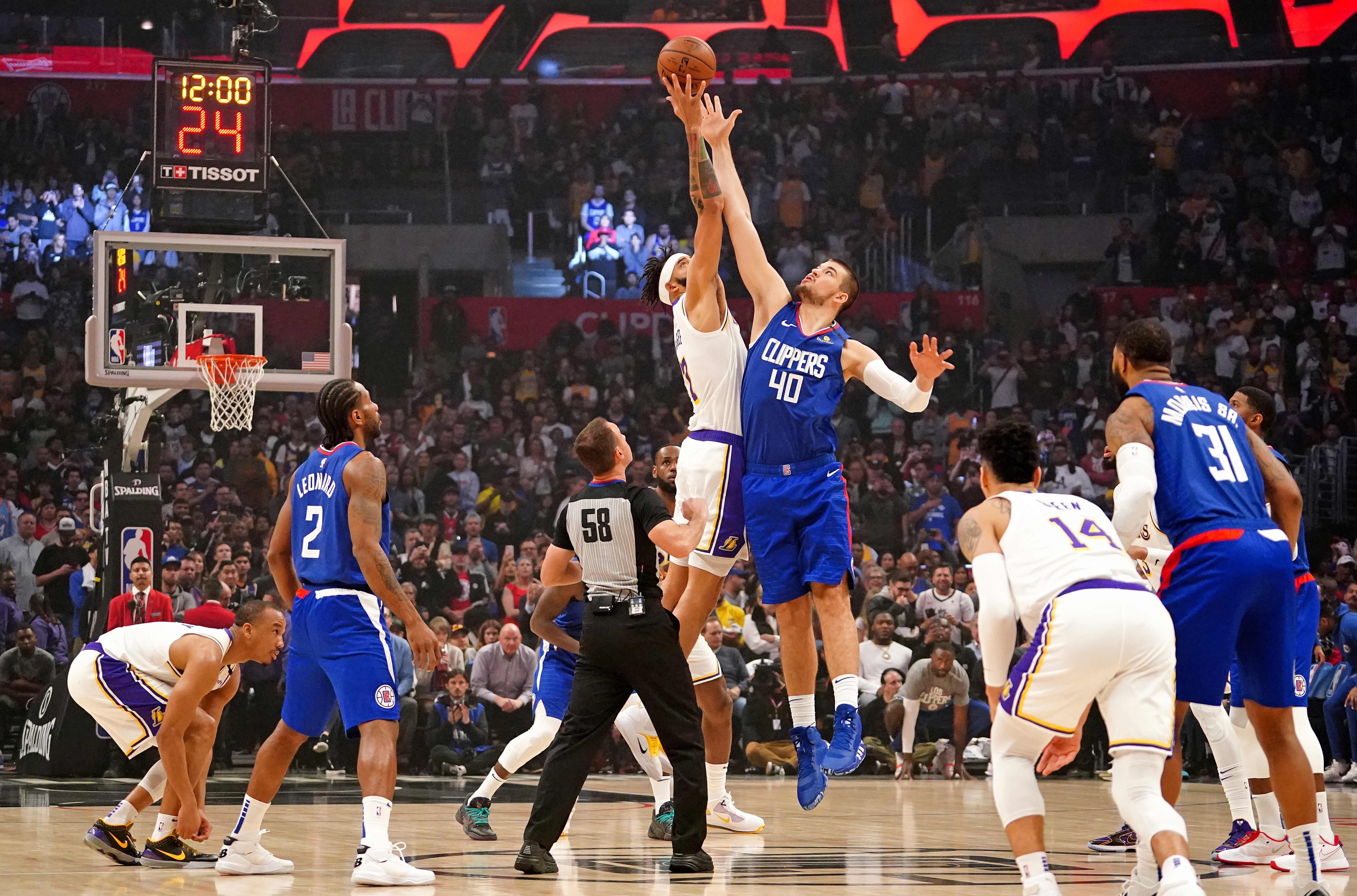 Los Angeles Lakers center JaVale McGee and LA Clippers center Ivica Zubac battle for the opening tipoff during the first half at Staples Center.