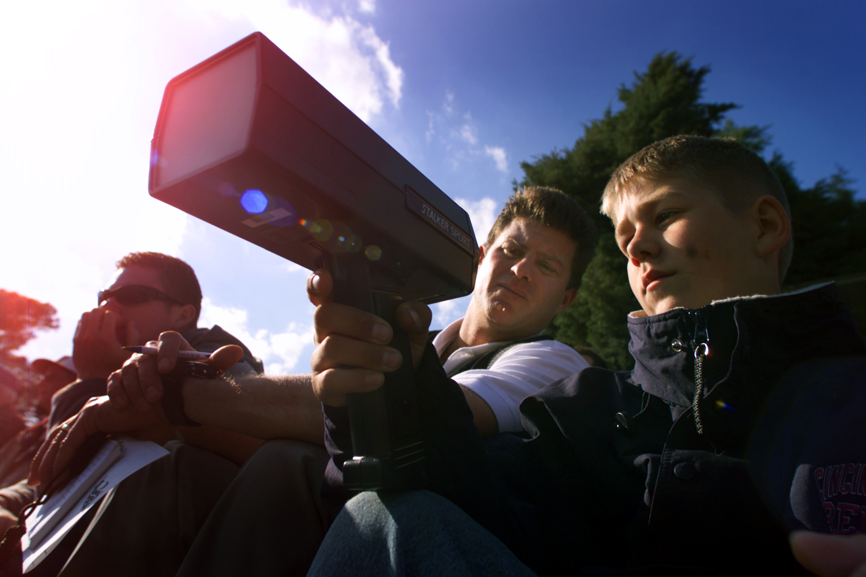 Nick LaVaseur, 12, right, holds a radar gun as he helps his dad Tom LaVaseur (CQ ALL), a scout for t