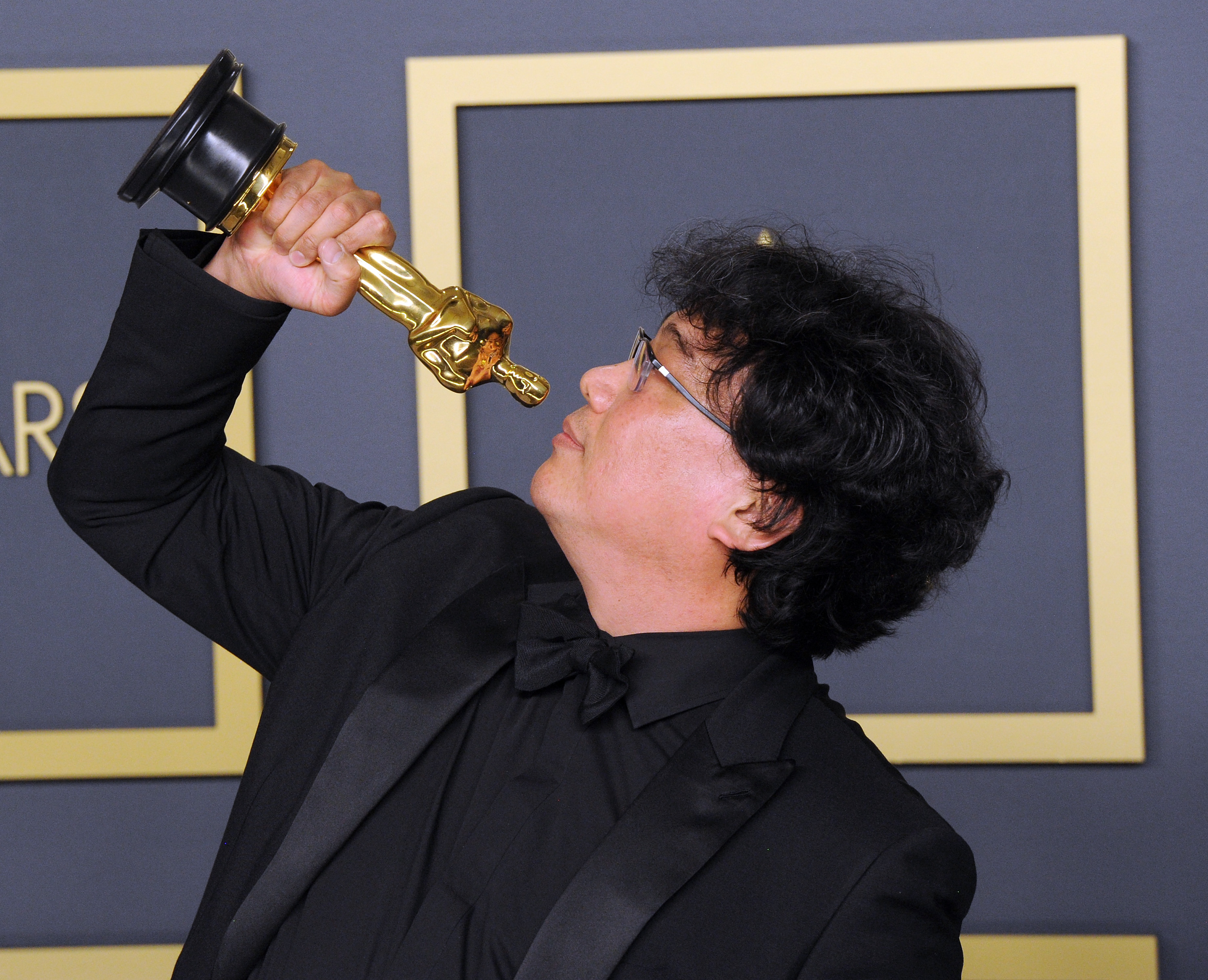 Bong Joon Ho poses with his Award for Best Director, Best Picture ('Parasite') inside The Press Room of the 92nd Annual Academy Awards held at Hollywood and Highland on February 9, 2020 in Hollywood, California.