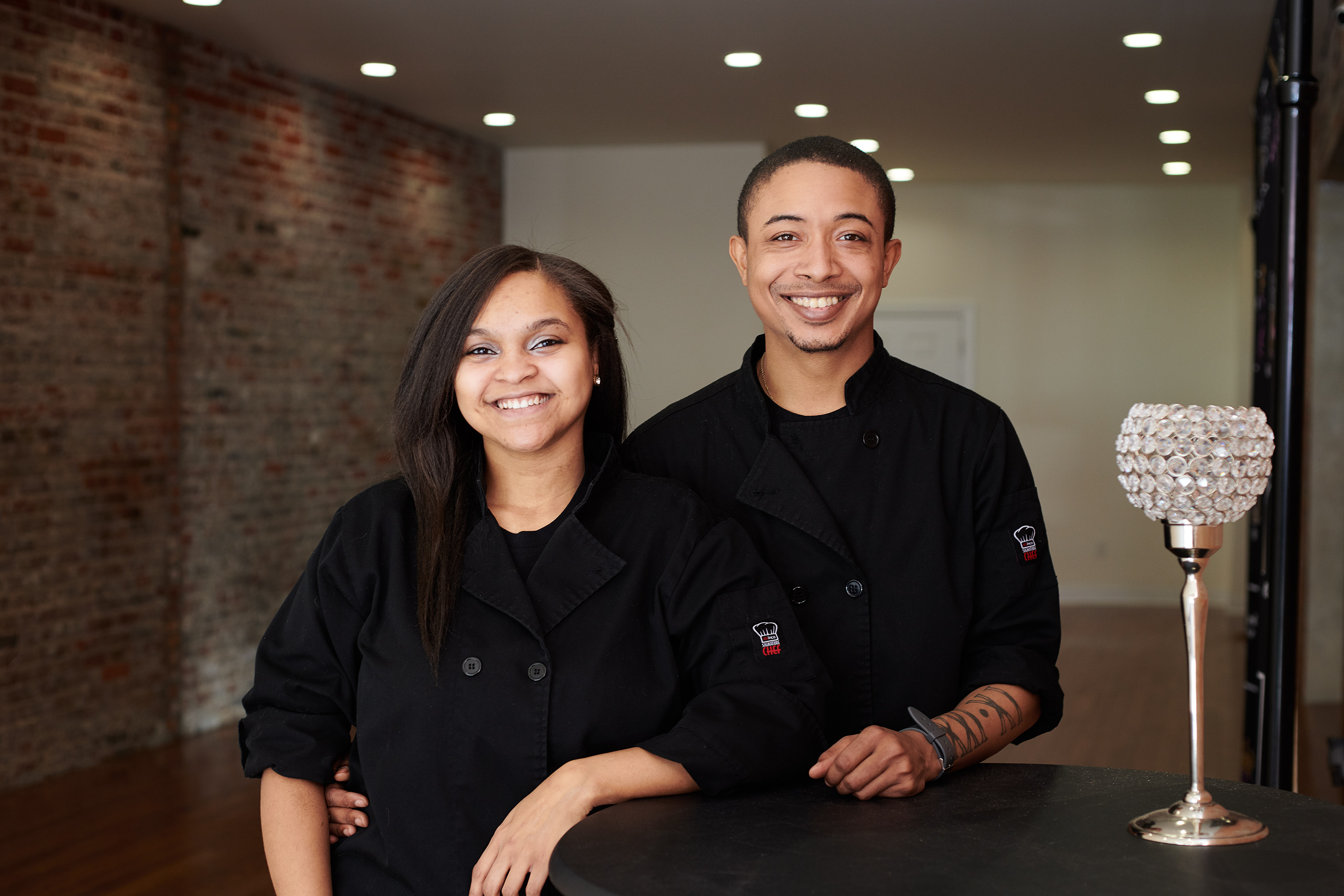 woman and man in black chef's coats