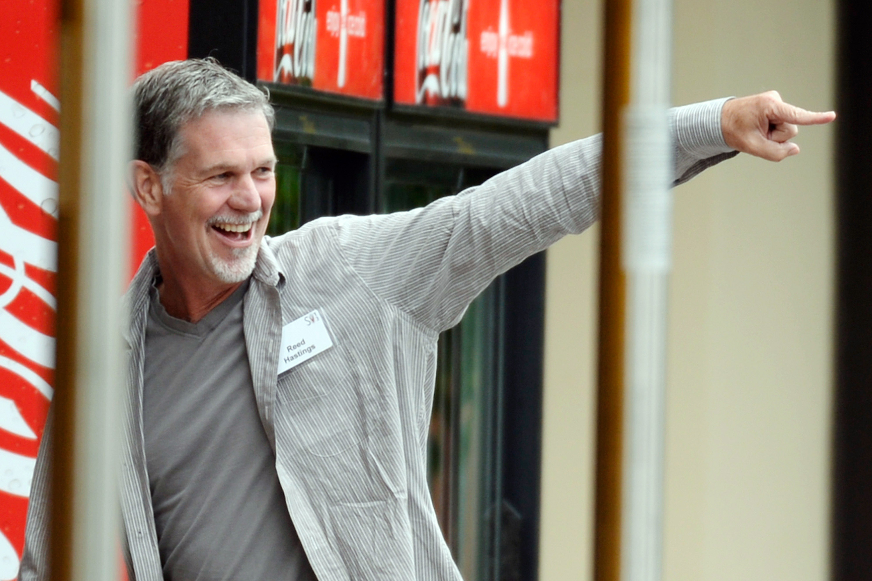 Reed Hastings smiling and pointing.