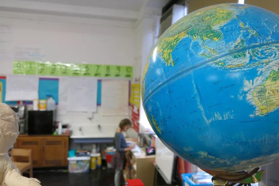 A globe inside of a classroom.