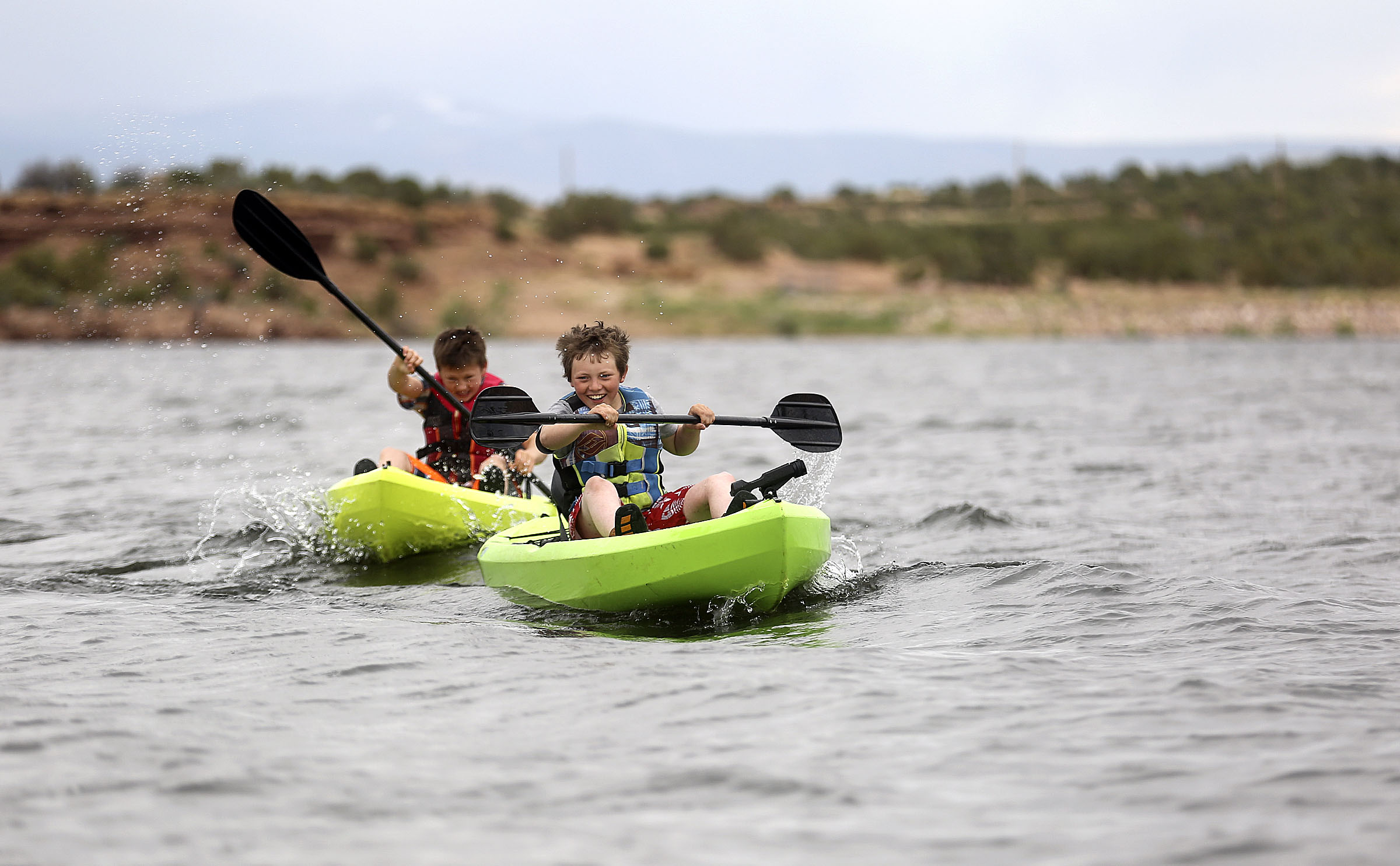 Jonathan Tibbets, front, and Logan Nelson, kayak on Big Sand Wash Reservoir near Altamont, Duchesne County, on Tuesday, June 16, 2020.