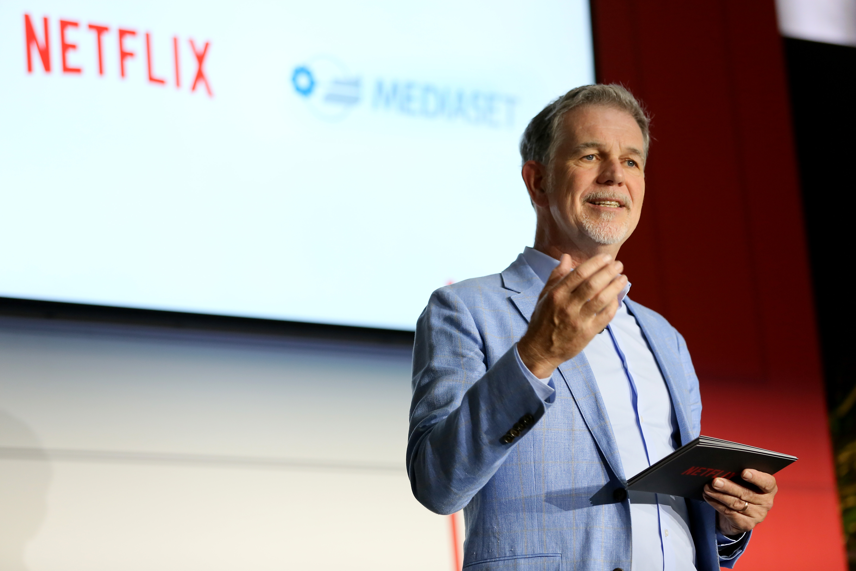 Reed Hastings speaks on stage