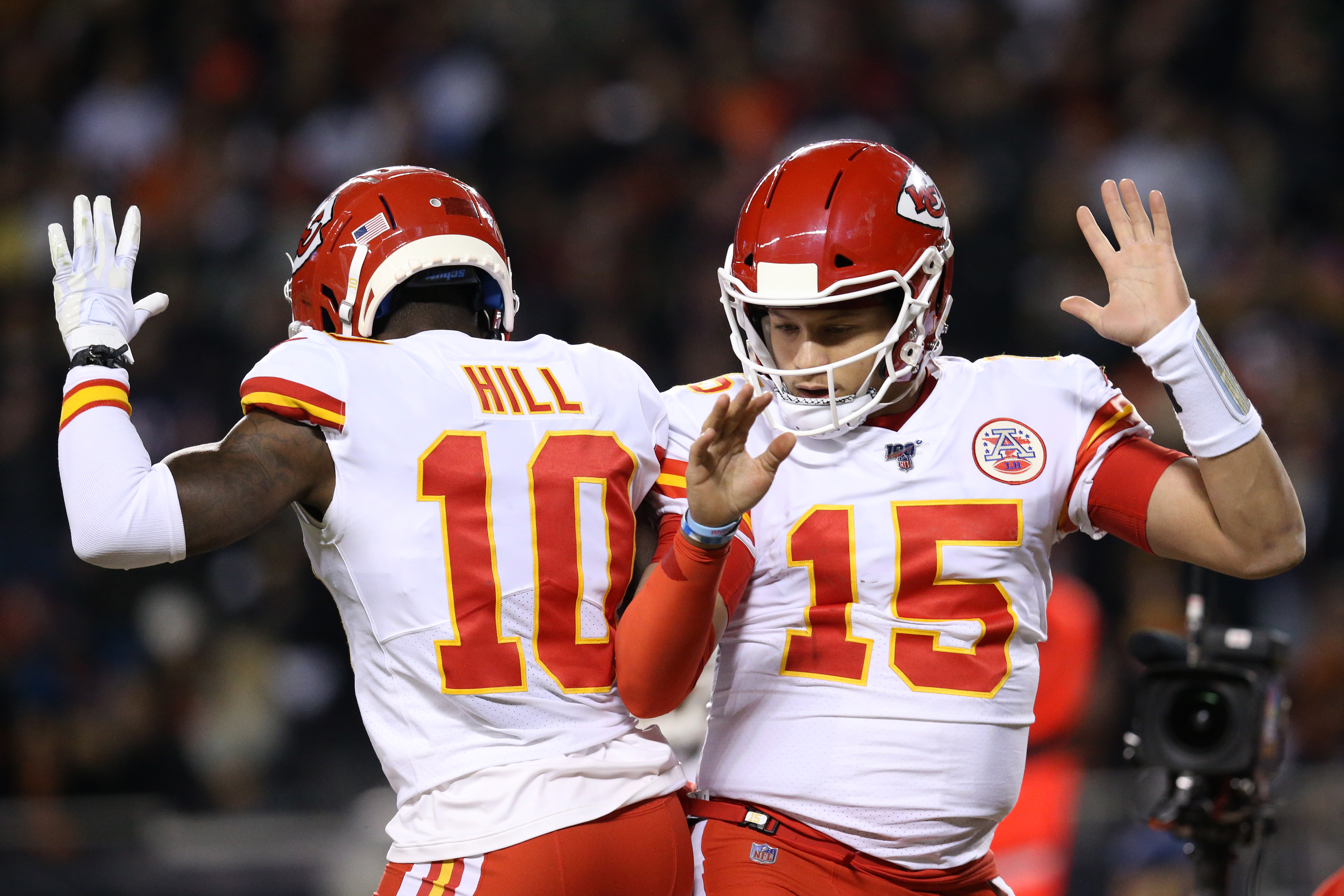 Quarterback Patrick Mahomes #15 of the Kansas City Chiefs celebrates with teammate wide receiver Tyreek Hill #10 after scoring a touchdown against the Chicago Bears in the first quarter of the game at Soldier Field on December 22, 2019 in Chicago, Illinois.