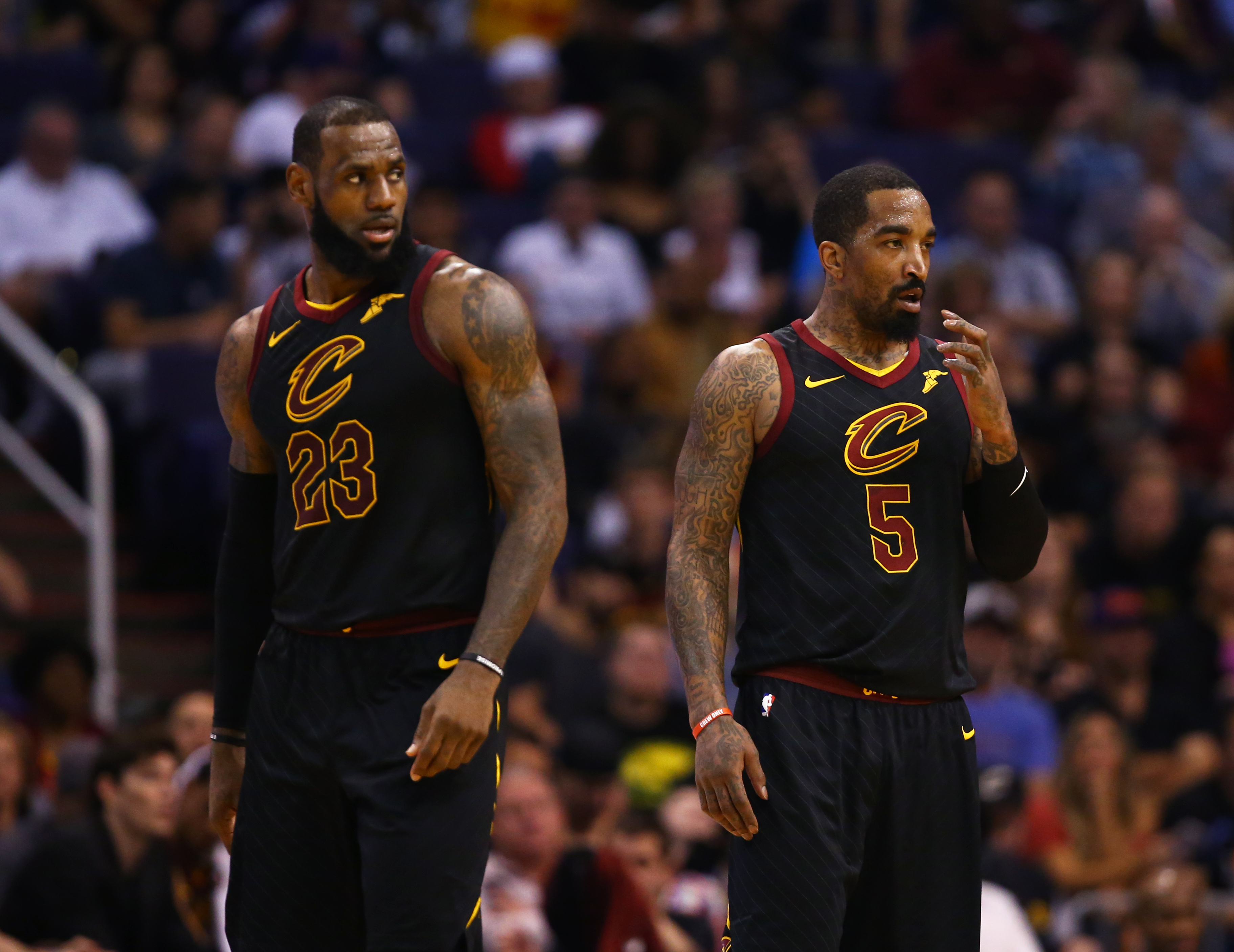 Cleveland Cavaliers forward LeBron James and guard J.R. Smith against the Phoenix Suns at Talking Stick Resort Arena.