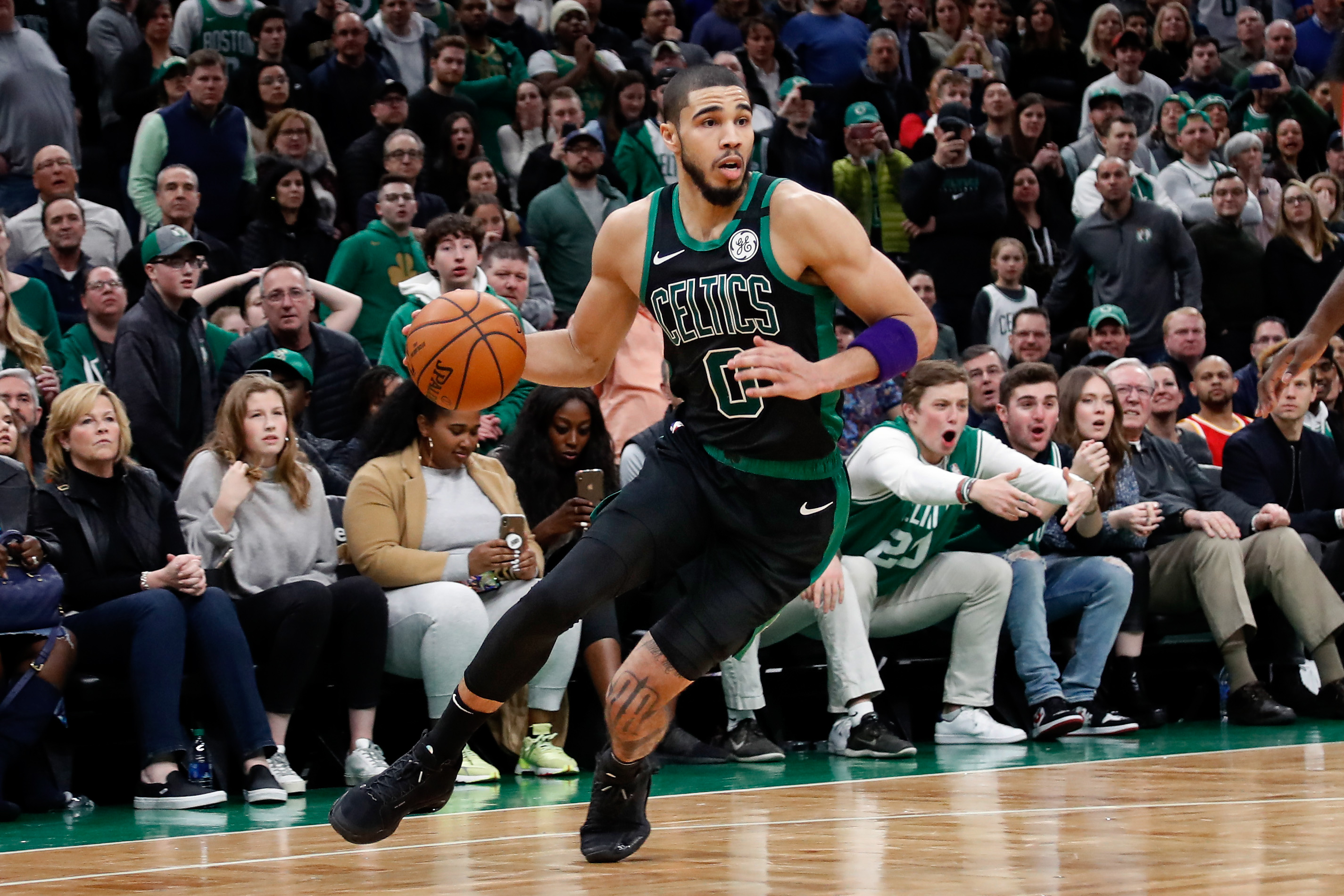 Boston Celtics forward Jayson Tatum drives during the second half against the Houston Rockets at TD Garden.